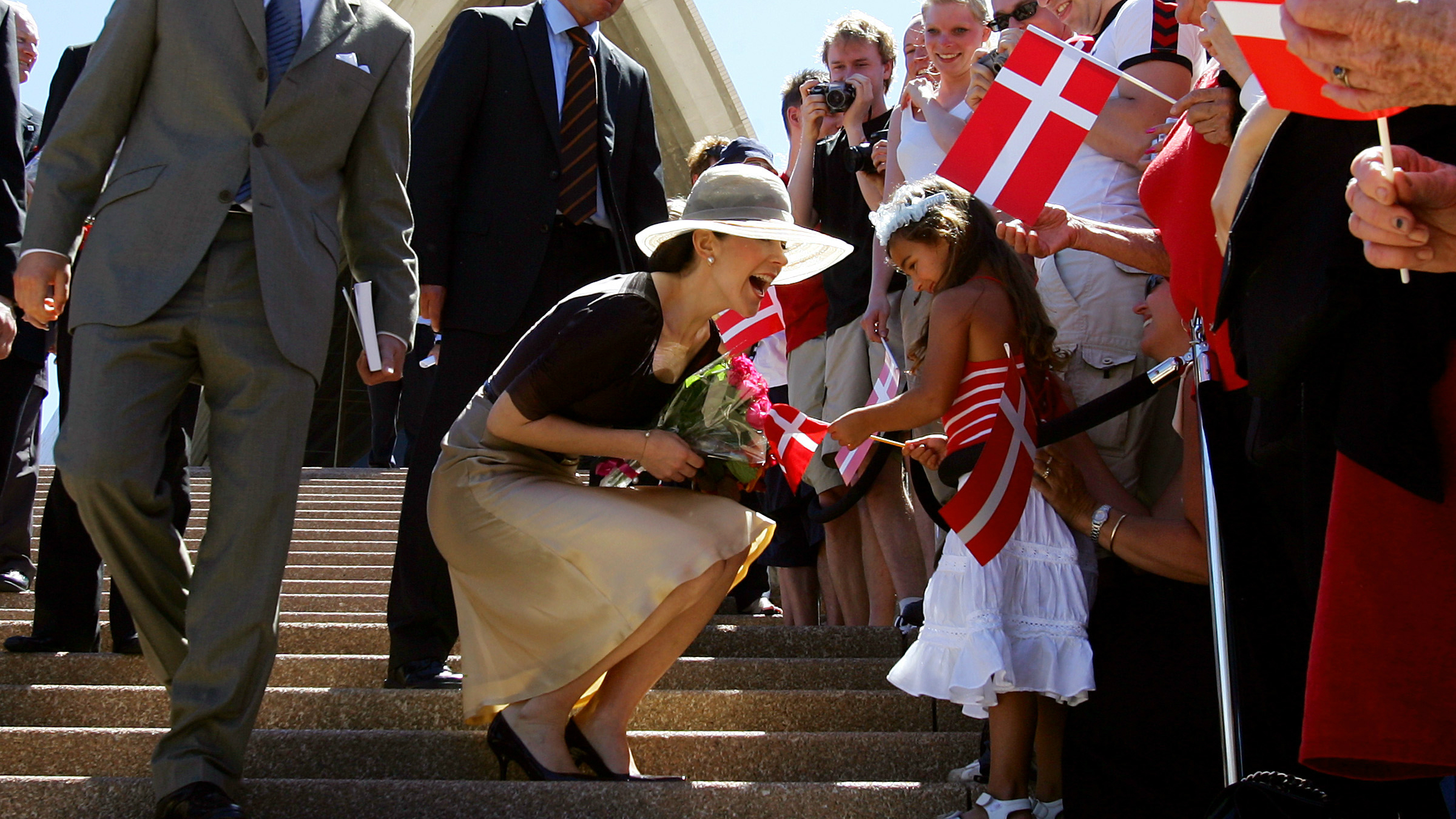 Denmark's Crown Princess Mary greets a girl in the crowd on the steps of the Sydney Opera House.