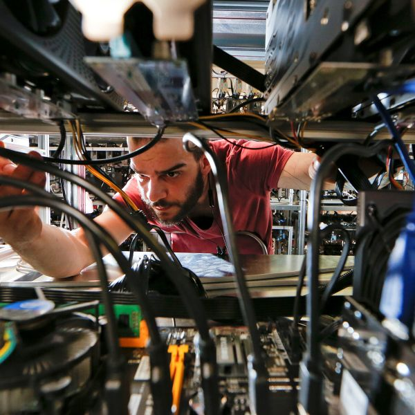 An employee works on bitcoin mining computers at Bitminer factory in Florence, Italy, April 9, 2018. Picture taken April 9, 2018.