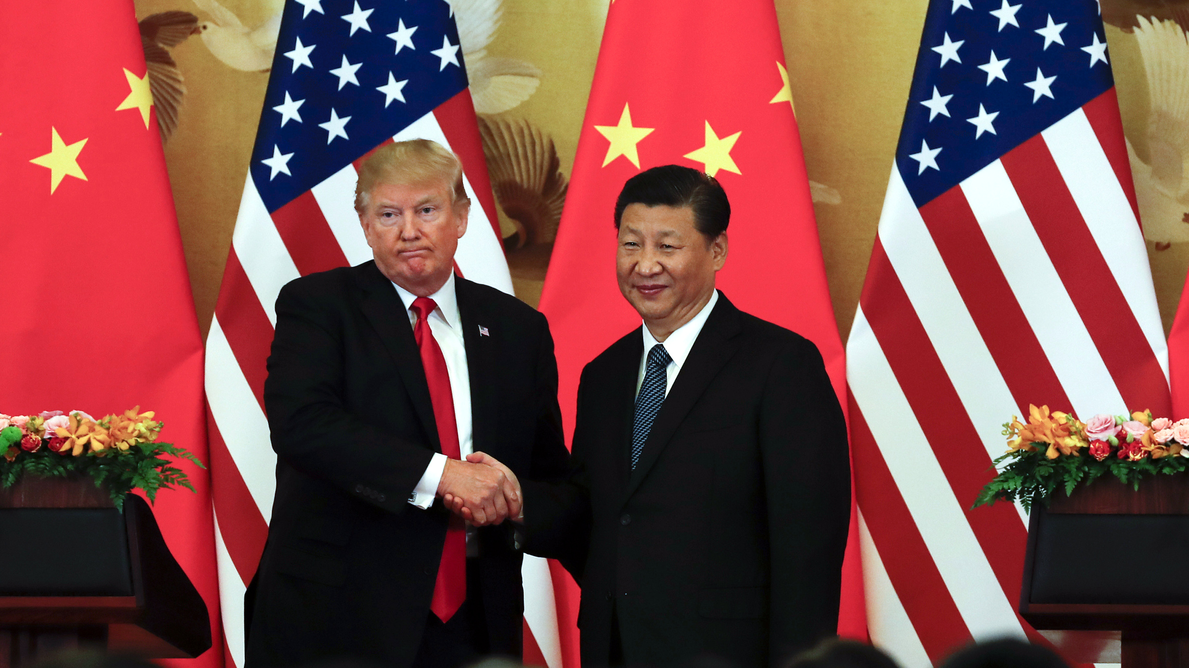 U.S. President Donald Trump, left, poses with Chinese President Xi Jinping for a photo after a joint press conference at the Great Hall of the People in Beijing, Thursday, Nov. 9, 2017. Trump is on a five-country trip through Asia traveling to Japan, South Korea, China, Vietnam and the Philippines.