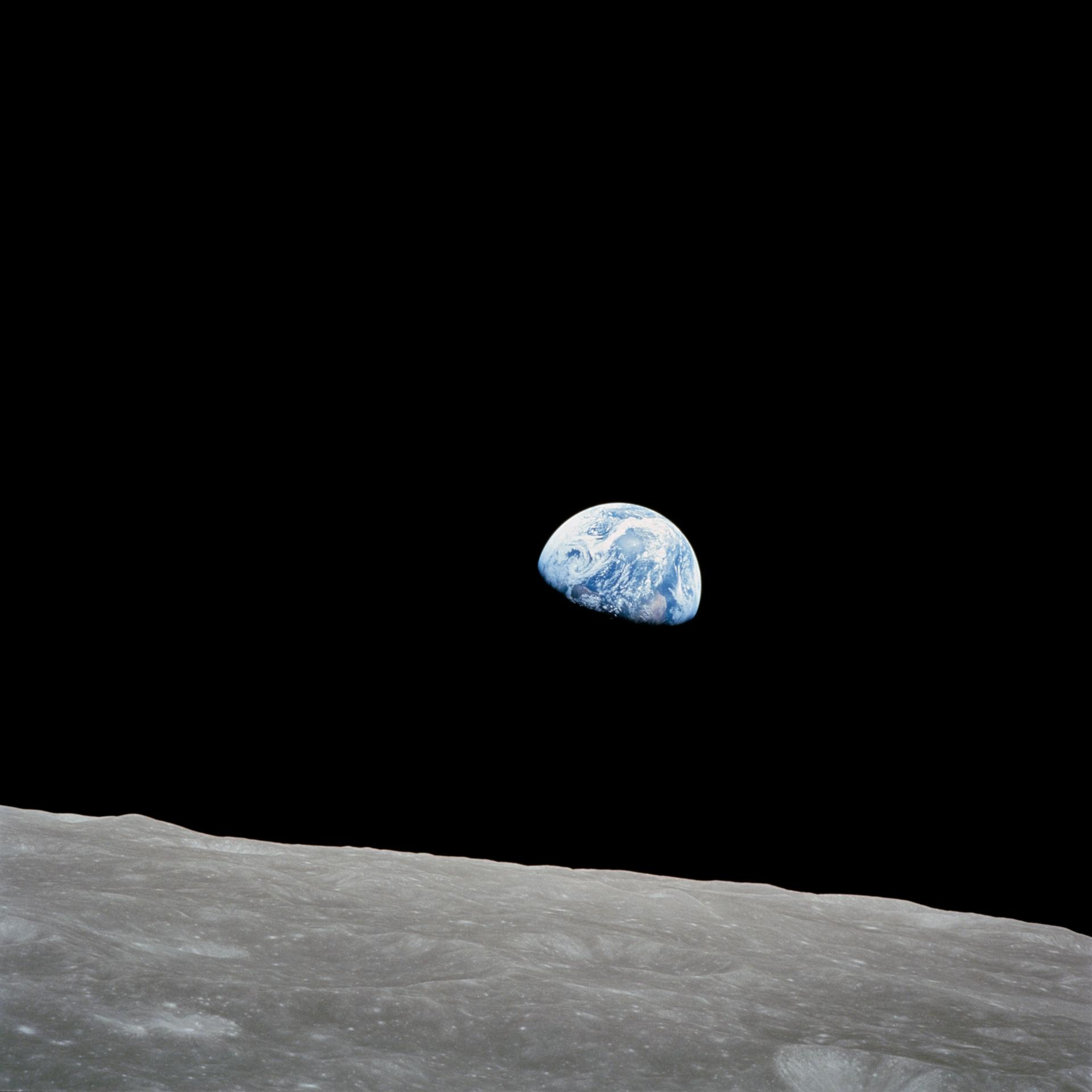 (24 Dec. 1968) --- The rising Earth is about five degrees above the lunar horizon in this telephoto view taken from the Apollo 8 spacecraft near 110 degrees east longitude.