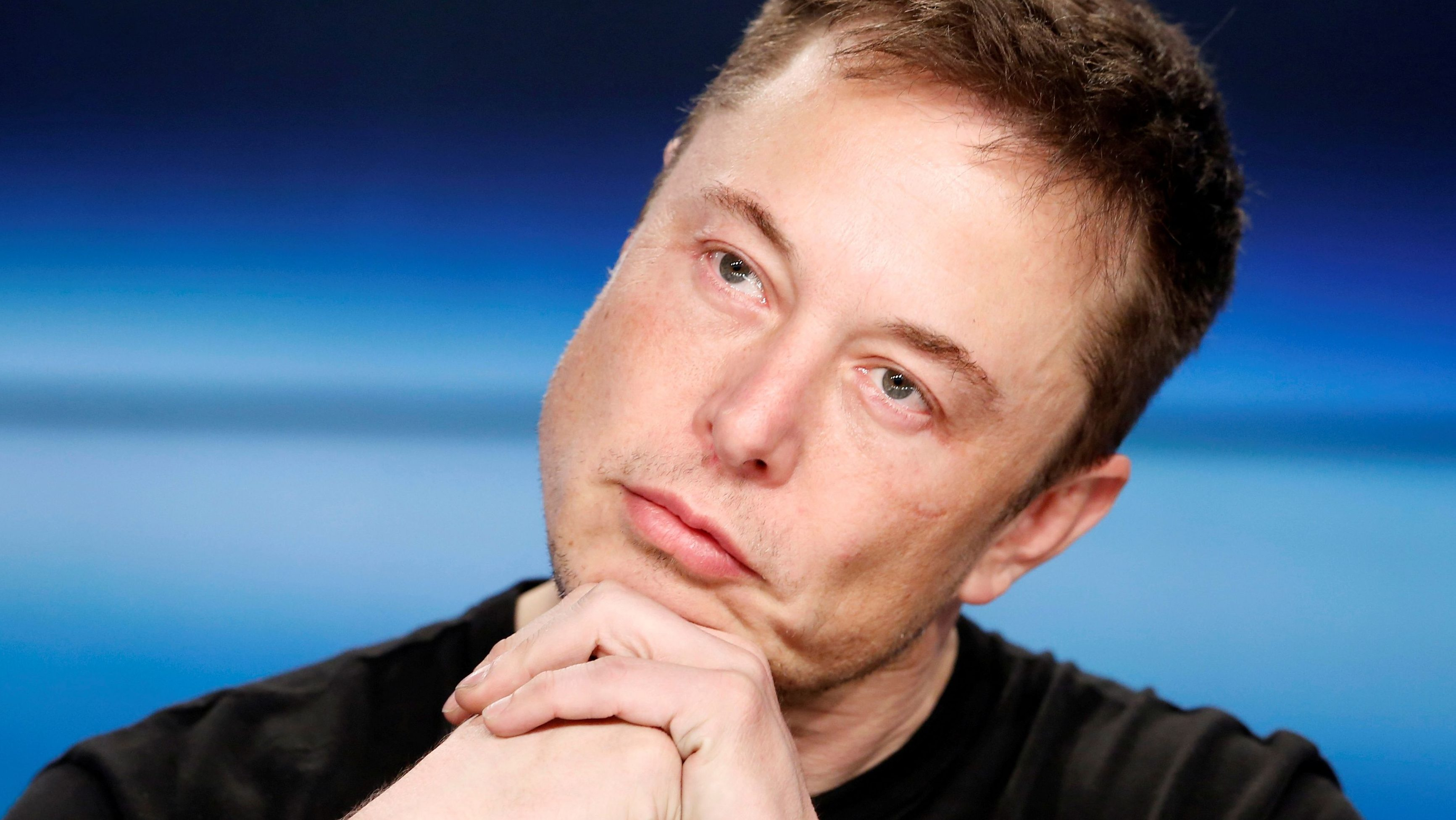 FILE PHOTO:    Elon Musk listens at a press conference following the first launch of a SpaceX Falcon Heavy rocket at the Kennedy Space Center in Cape Canaveral, Florida, U.S., February 6, 2018.  - RC1AD9ED5280