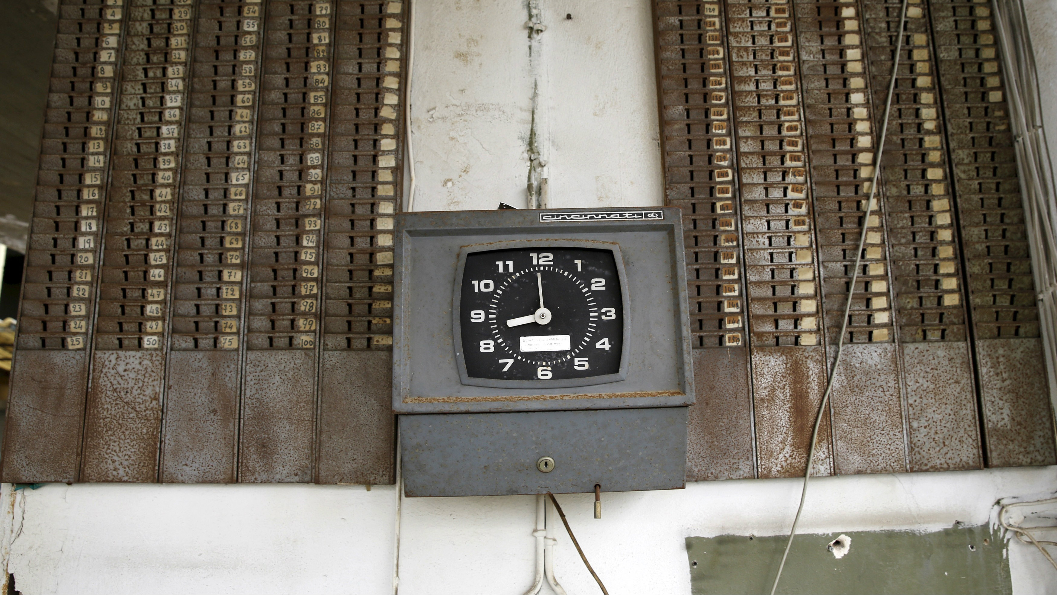 A punch clock is seen at the entrance of a deserted cooking oil factory that closed in 1996 in the town of Elefsina in Sterea Hellas region, Greece April 28, 2015. As Athens faces growing pressure to reach agreement with lenders to avoid financial chaos, an angry Greek public feels the pain of cuts following a six-year recession, with unemployment more than double the euro zone average. A 2,500 km trip from Athens to northeastern Greece and back via the Peloponnese region in the south shows the remnants of a once-flourishing Greek industry, which has suffered a 30 percent drop in production from its peak. Abandoned factories, previously making goods from timber to textiles and cooking oil, are often looted, adding to the scenes of desolation.