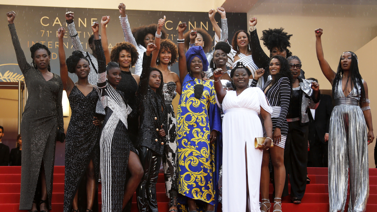 "71st Cannes Film Festival - Screening of the film ""Burning"" (Beoning) in competition - Red Carpet Arrivals - Cannes, France May 16, 2018. French actresses Nadege Beausson-Diagne, Mata Gabin, Maimouna Gueye, Eye Haidara, Rachel Khan, Aissa Maiga, Sara Martins, Marie-Philomene Nga, Sabine Pakora, Firmine Richard, Sonia Rolland, Magaajyia Silberfeld, Shirley Souagnon, Assa Sylla, Karidja Toure, who collaborated for the publication of the book ""Noire níest pas mon metier"" (Black is not my job) and Khadja Nin, member of the 71st Cannes Film Festival Jury pose. REUTERS/Jean-Paul Pelissier - UP1EE5G18X74M"