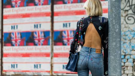 MILAN, ITALY - SEPTEMBER 22: Lisa Hahnbeuck (@lisarvd) wearing Lala Berlin Backless Cropped Silk Top with Long Sleeves, jeans Levi's Wedgie, bag Fendi Peekaboo outside Fendi during Milan Fashion Week Spring/Summer 2017 on September 22, 2016 in Milan, Italy. (Photo by Christian Vierig/Getty Images)
