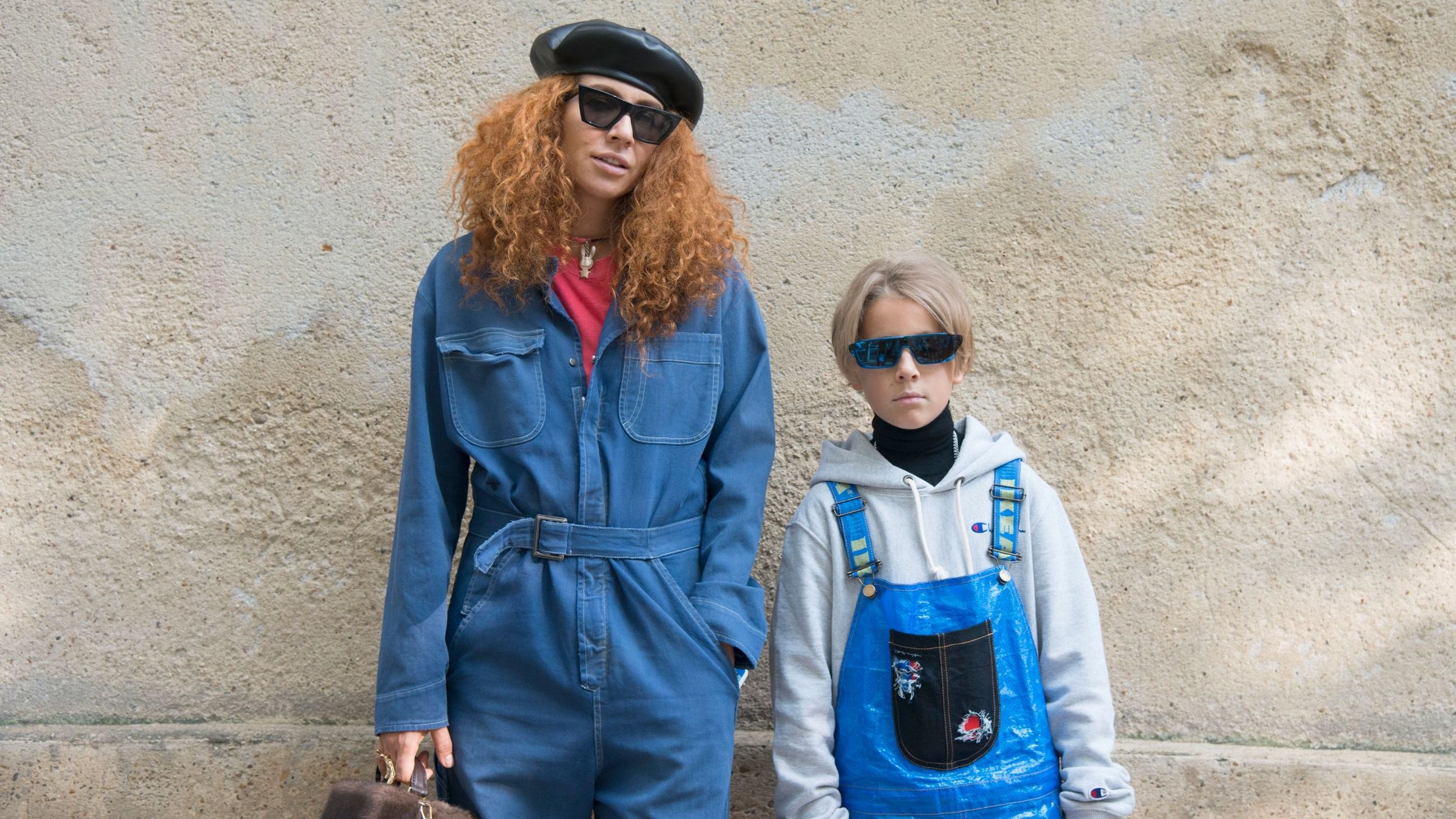 PARIS, FRANCE - SEPTEMBER 26 : Jewellery designer Natasha Zinko wears a Dior jumpsuit, Celine sunglasses and Natasha Zinko bag and jewellery with Ivan Zinko wears a DIY jumpsuit, Dior x Rihanna sunglasses, Prada turtleneck sweater, Champion hooded top day 1 of Paris Womens Fashion Week Spring/Summer 2018, on September 26, 2017 in London, England. (Photo by Kirstin Sinclair/Getty Images)