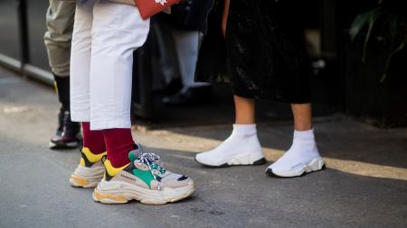 MILAN, ITALY - JANUARY 13: Guests wearing Balenciaga sneakers seen outside Dolce & Gabbana during Milan Men's Fashion Week Fall/Winter 2018/19 on January 13, 2018 in Milan, Italy. (Photo by Christian Vierig/Getty Images)