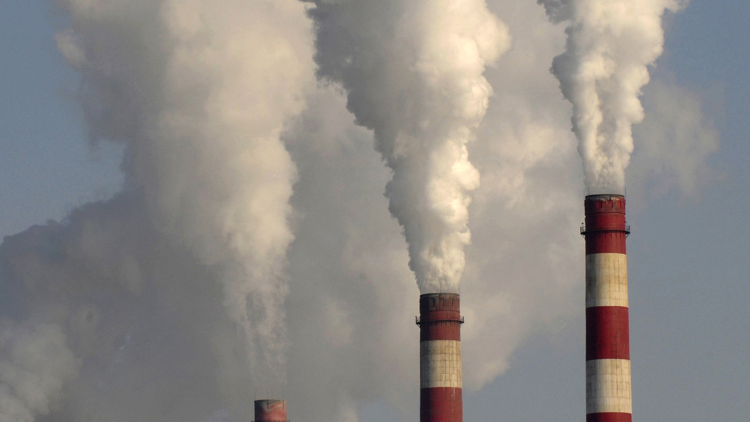 Smoke rises from chimneys of a power plant in Changzhi, Shanxi province November 17, 2009.