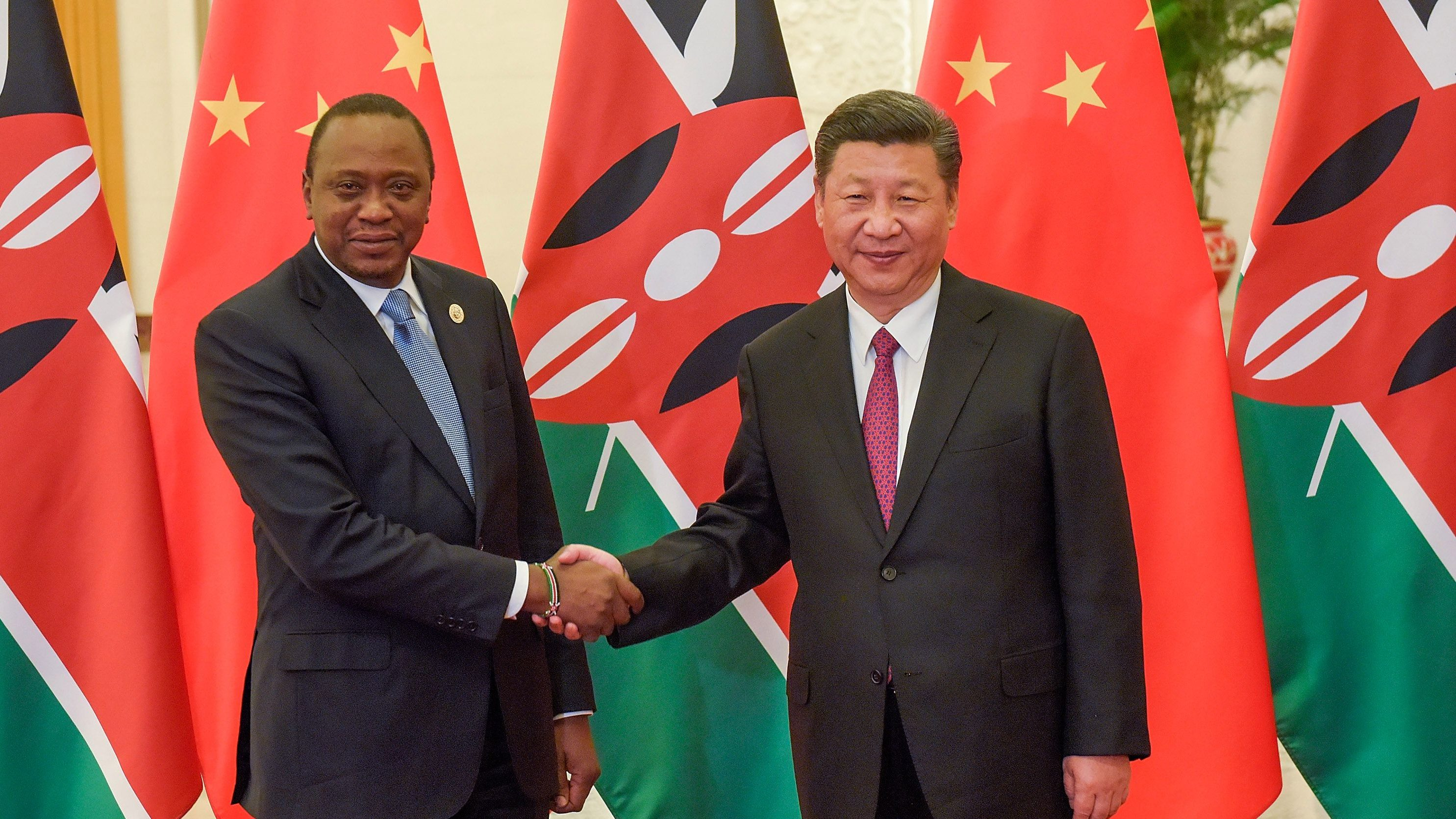Chinese President Xi Jinping (R) and Kenyan President Uhuru Kenyatta (L) shake hands as they pose for the media prior to their bilateral meeting during the Belt and Road Forum for International Cooperation at the Great Hall of the People in Beijing, China, 15 May 2017.
