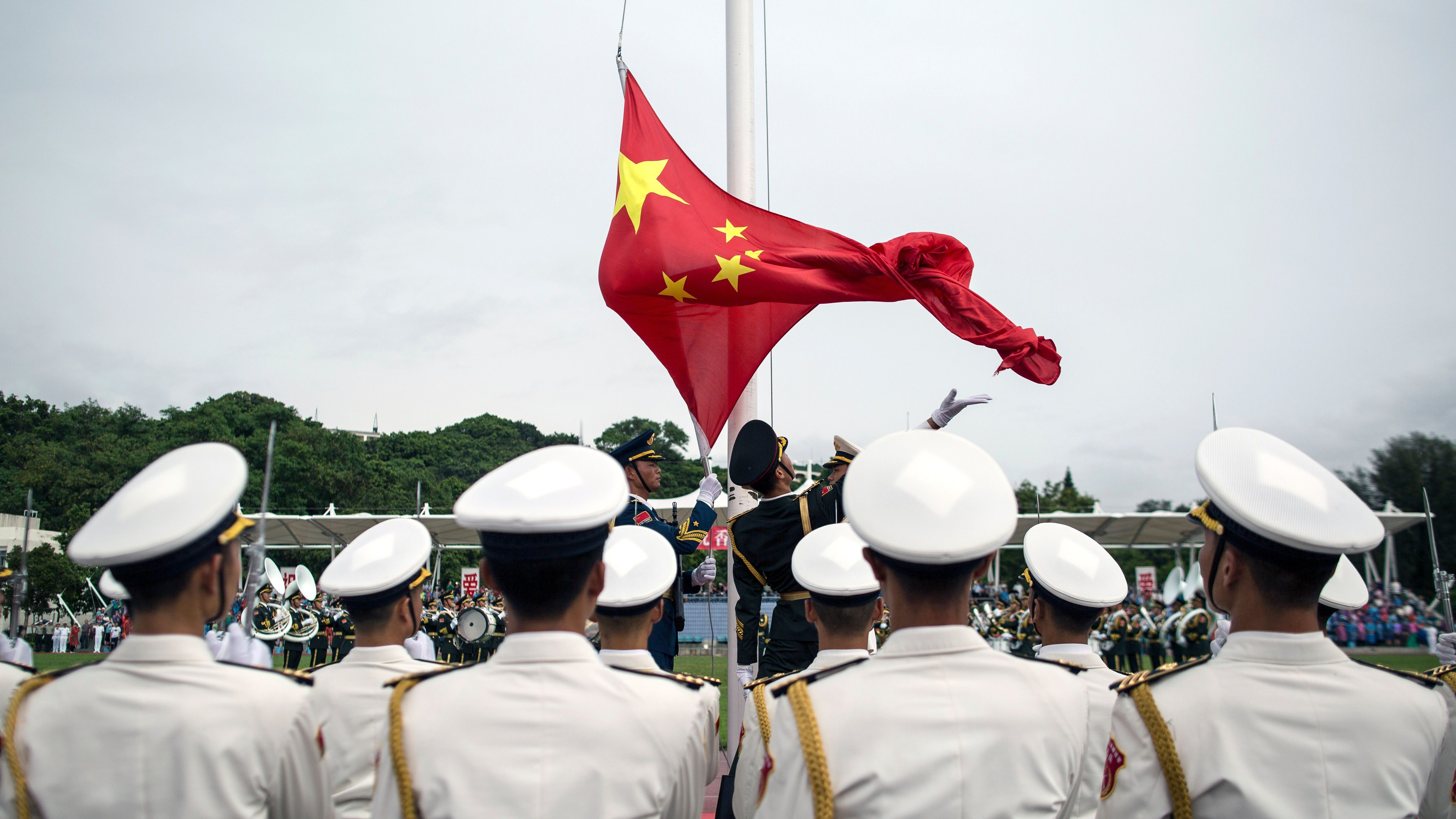 People's Liberation Army (PLA) soldiers participate in a flag raising ceremony during an open day at the PLA navy base in Hong Kong, China, 08 July 2017 (reissued 12 July 2017). According to reports, China ships carrying military personnel departed on 11 July 2017 from Zhanjiang, southern China and set sails to Djibouti. China is to establish it's fiorst ever overseas military base in the Djibouti, at the Horn of Africa.