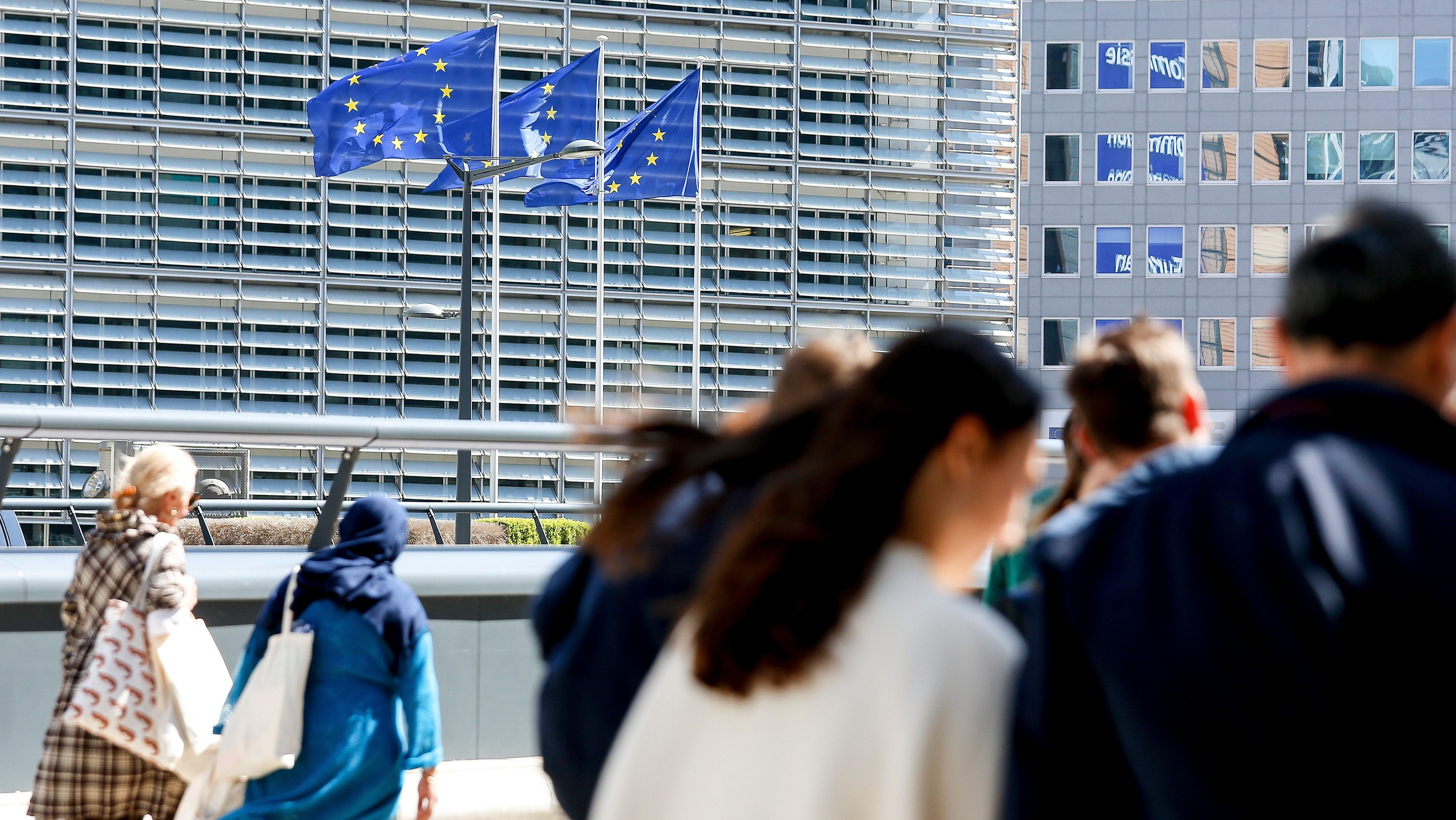 European Union flags fly near the seat of the European Commission at the Berlaymont building in Brussels, Belgium.