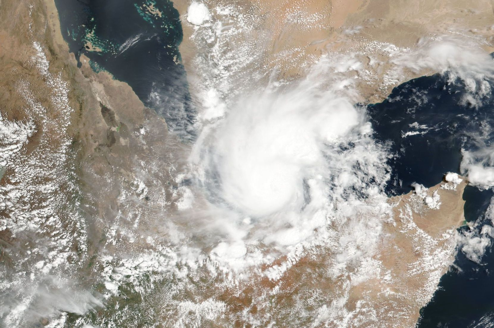 A handout photo made available by the NASA on 19 May 2018 shows a satellite image of tropical storm Sagar developing over the Gulf of Aden, 18 May 2018. The small tropical storm which is very rare to appear in the area is estimated to hit Djibouti and northern Somalia on 19 May 2018.    HANDOUT EDITORIAL USE ONLY/NO SALES