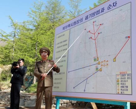A North Korean official speaks to the media about the dismantling process prior to the detonation of explosives during the first day of dismantling at North Korea's Punggye-ri nuclear test site in Punggye-ri, North Korea, 24 May 2018 (issued 25 May 2018). On 24 May North Korea started to demolish its Punggye-ri nuclear test facility, in the country's northeast. South Korean journalists covering the process said the demolition of the site was carried out in a series of explosions over several hours on the day.