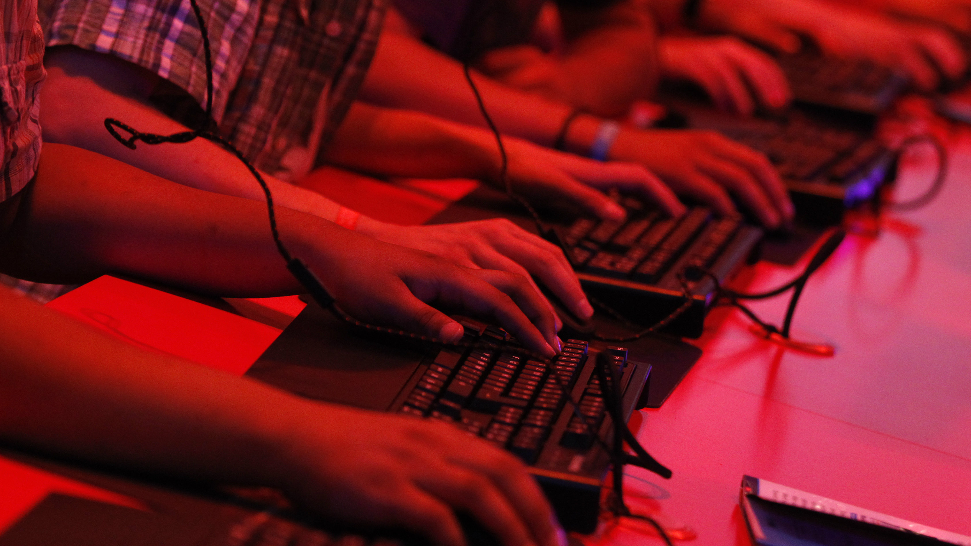 "Visitors play use keyboards as they play ""Diablo"" during the Gamescom 2012 fair in Cologne August 16, 2012. The Gamescom convention, Europe's largest video games trade fair, runs from August 16 to August 19."