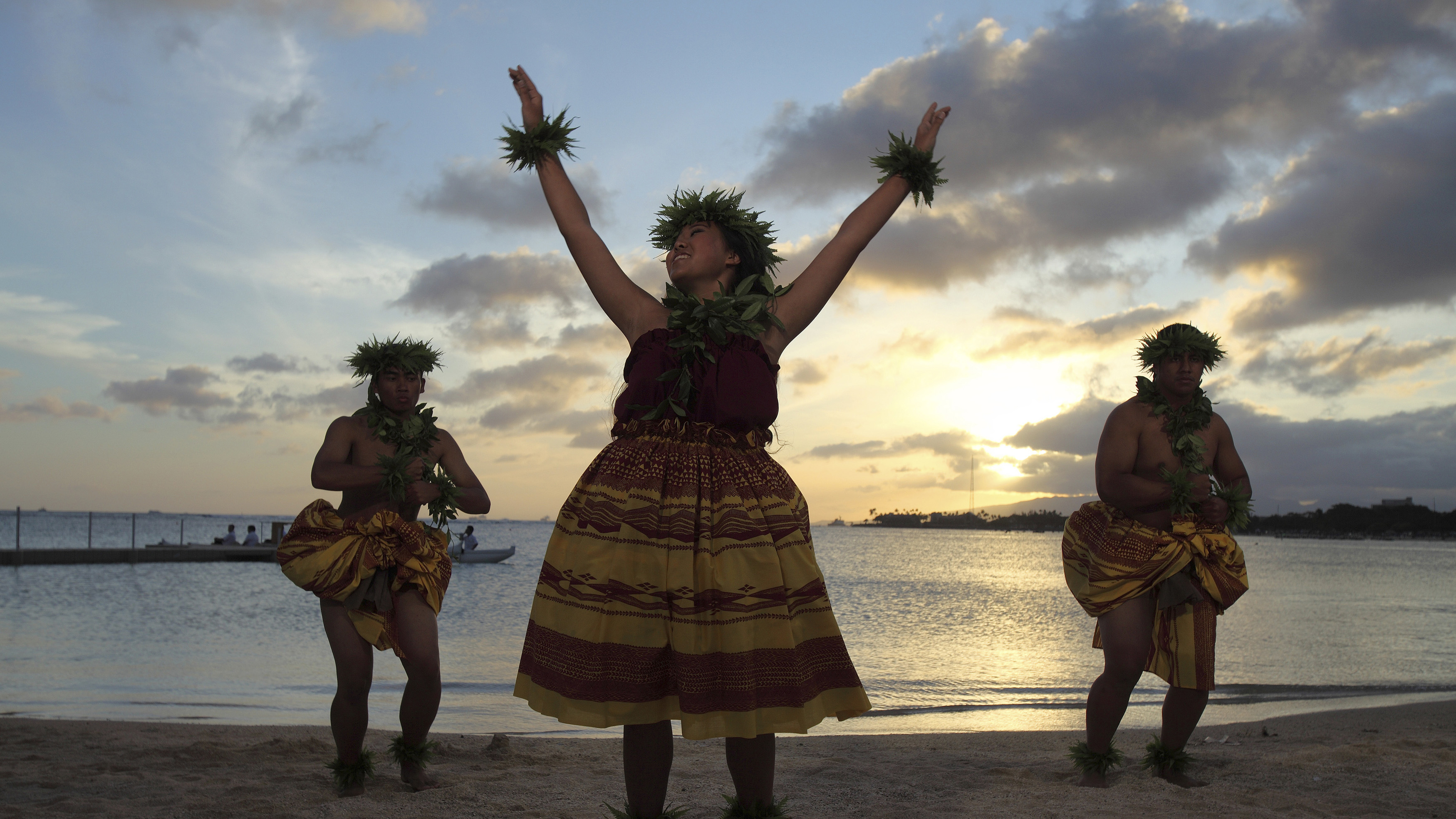 Hula dancers perform during the Na Lei Aloha Lantern Floating event held by the Shinnyo-en Buddhist organization at Ala Moana beach park on Memorial Day in Honolulu, Hawaii, May 28, 2012.The event is held in honor of those killed by war, natural disasters and health reasons. REUTERS/Hugh Gentry (UNITED STATES - Tags: ANNIVERSARY SOCIETY) - GM1E85T1D9E01
