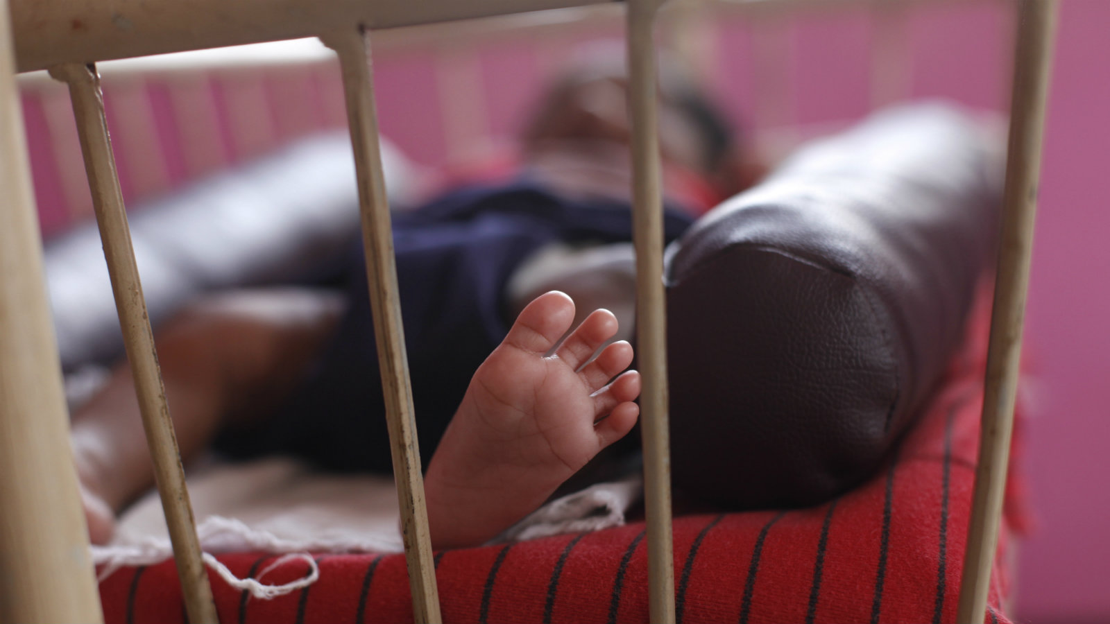 """A baby girl is seen lying in a cradle inside the Life Line Trust orphanage in Salem in the southern Indian state of Tamil Nadu June 20, 2013. These unwanted infant girls in southern India's Tamil Nadu state are considered the fortunate ones. They are India's """"Cradle Babies,"""" products of a government scheme that permits parents to give their unwanted baby girls anonymously to the state, saving them from possible death in a region where daughters are seen as a burden and where their murder is a common reality. Picture taken June 20, 2013. To match INDIA-CRADLEBABIES/"""