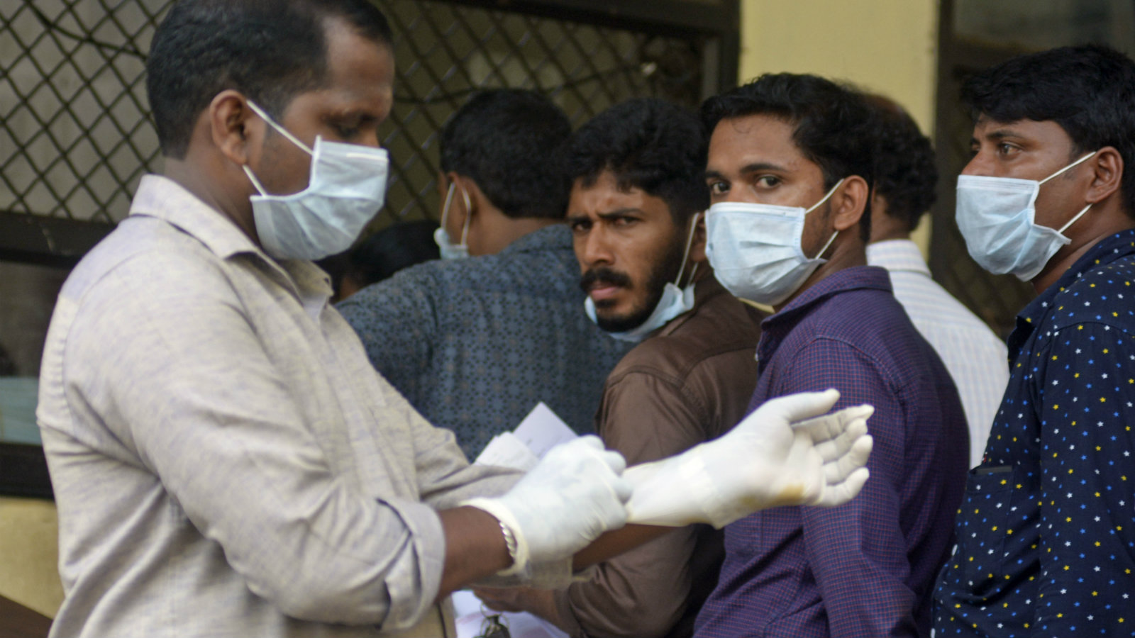Indians standing in a queue outside a hospital wear masks as a precautionary measure against the Nipah virus at the Government Medical College hospital in Kozhikode, in the southern Indian state of Kerala, Monday, May 21, 2018. The deadly virus has killed at least three people in southern India, officials said Monday, with medical teams dispatched to the area amid reports that up to six other people could have died from the disease and others are ill.