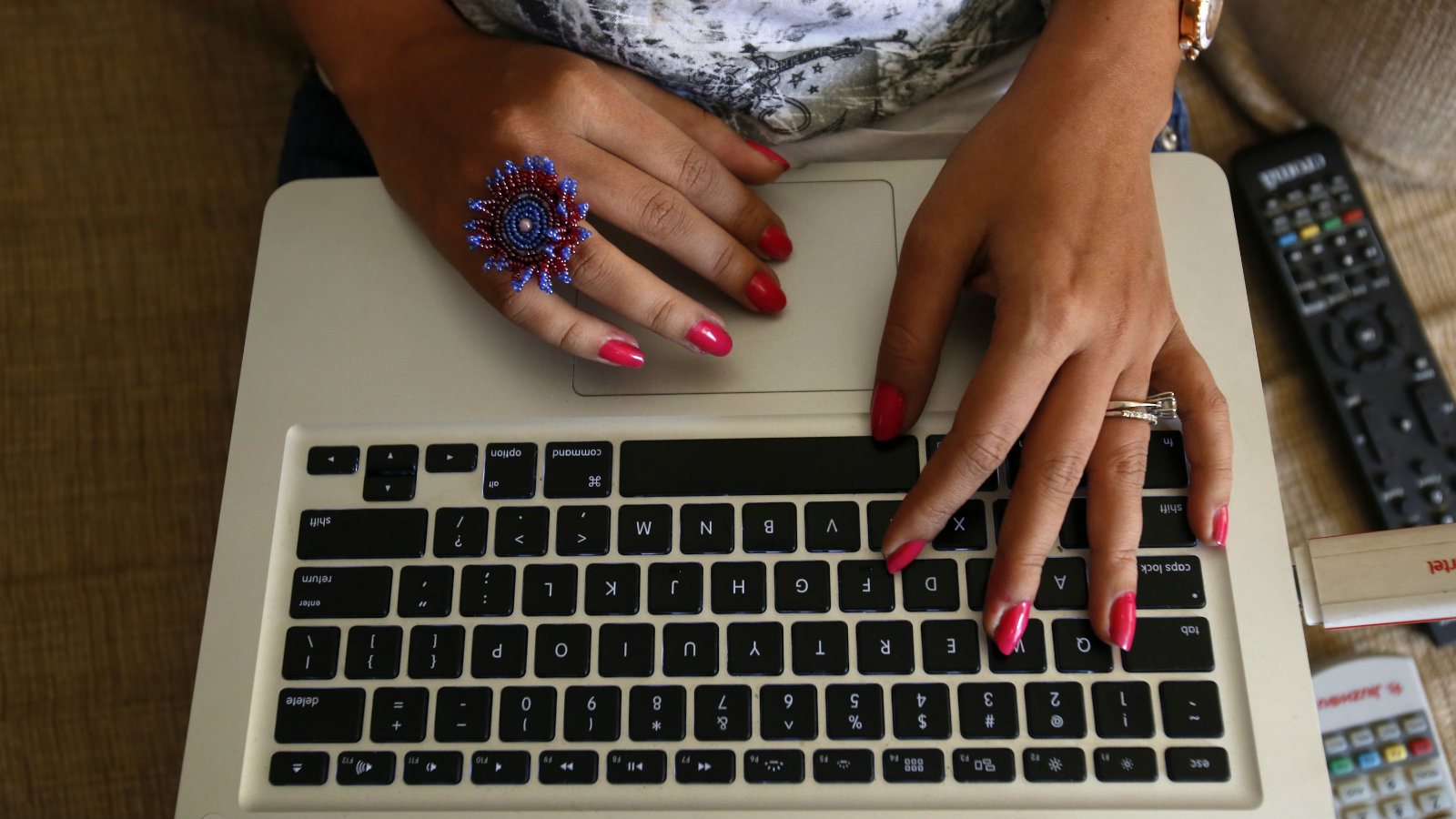 """The hands of Malini Agarwal, blogger-in-chief of missmalini.com, are pictured as she blogs from her living room in Mumbai, January 22, 2013. Agarwal, 35, exemplifies what aspirational India is all about - She's bubbly, energetic, and describes herself as """"India's blogging princess"""" and a """"social media Jedi"""". She's been called """"without a doubt, India's most famous blogger"""". Her blog, missmalini.com, gets over 250,000 unique visitors a month. It provides a steady diet of Bollywood gossip, fashion, food and entertainment to a legion of followers."""