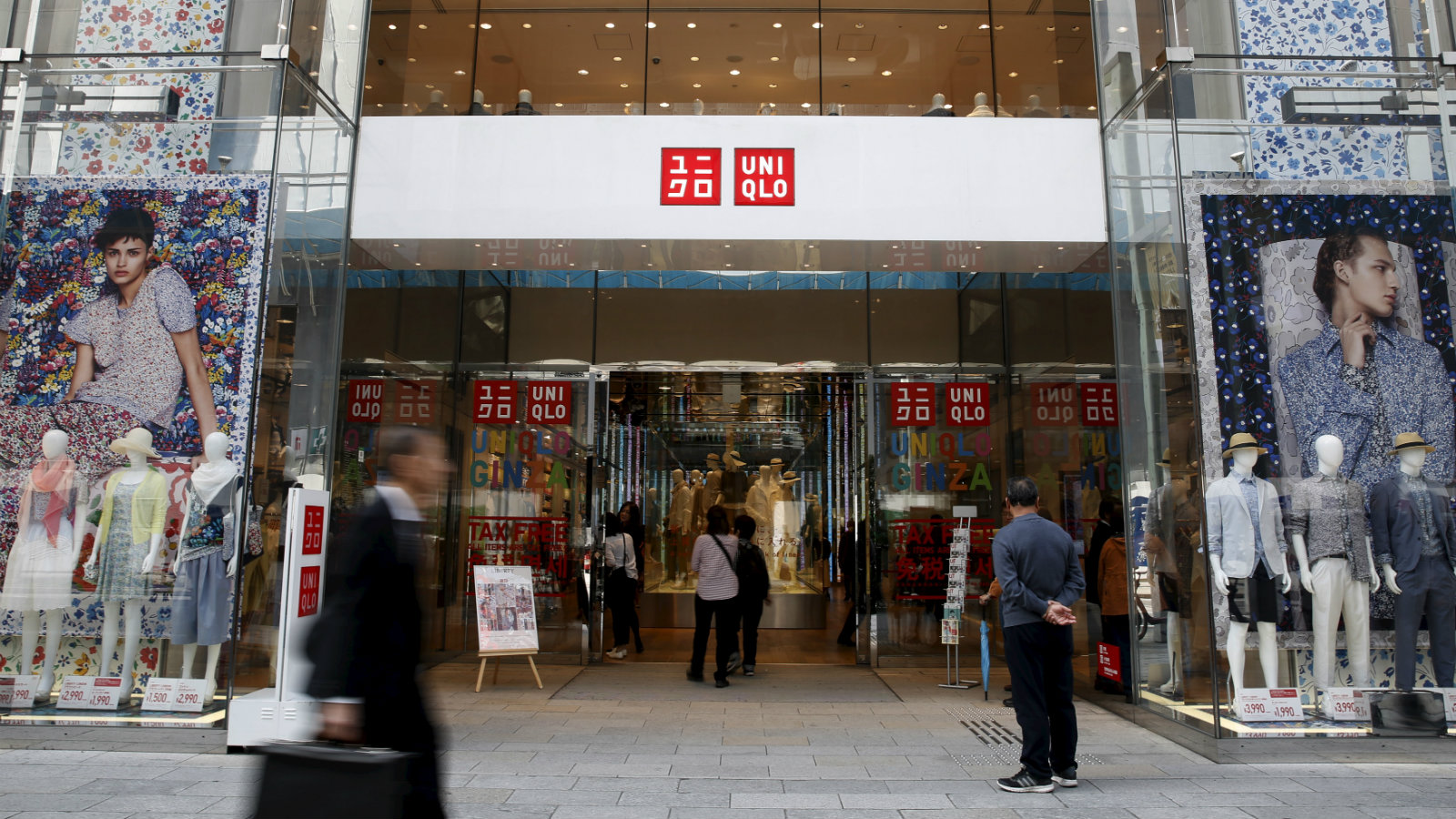 A man stands in front of a Fast Retailing's Uniqlo store in Tokyo, Japan, April 6, 2016. Picture taken April 6, 2016.