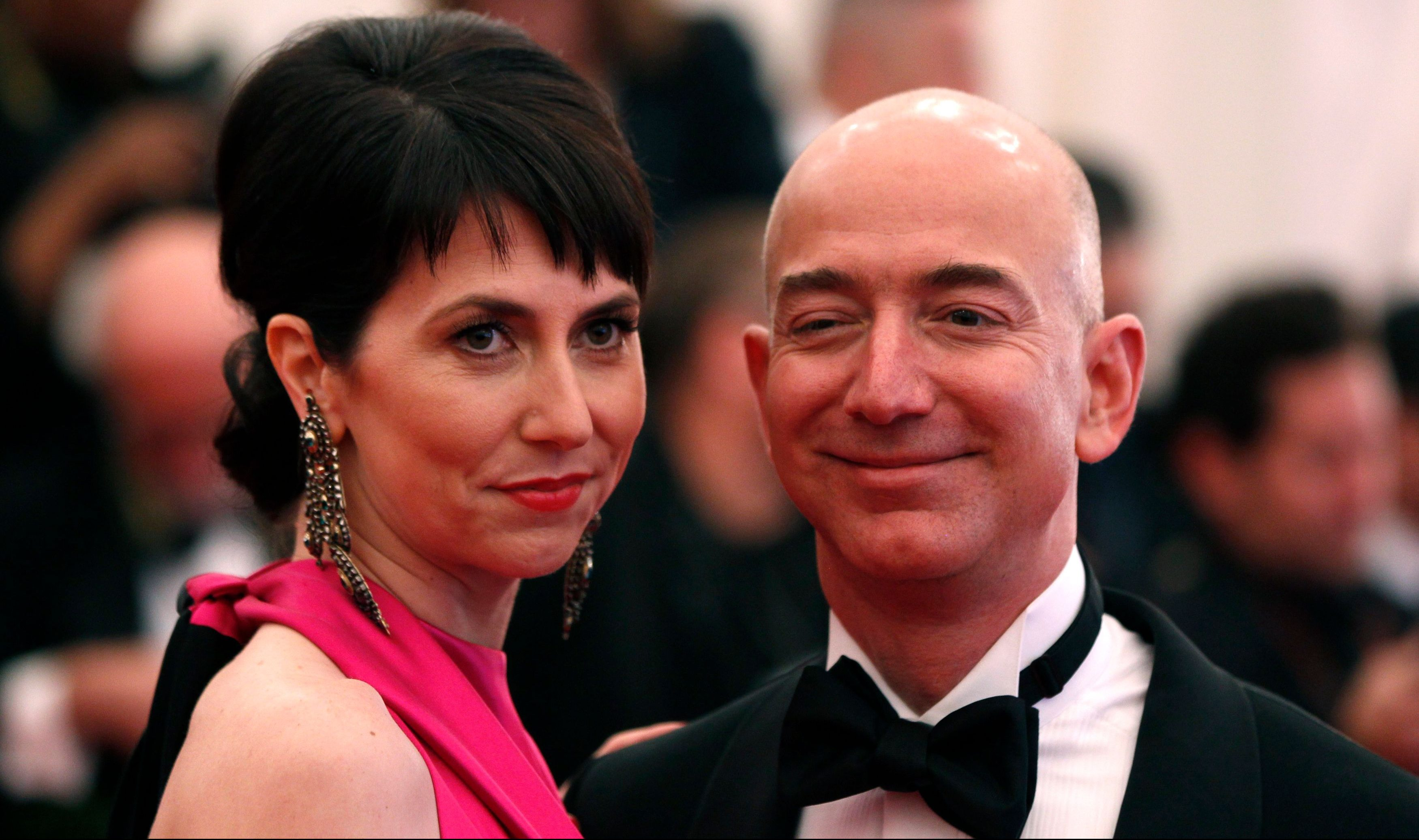 "Amazon CEO Jeff Bezos and wife Mackenzie Bezos arrive at the Metropolitan Museum of Art Costume Institute Benefit celebrating the opening of ""Schiaparelli and Prada: Impossible Conversations"" exhibition in New York, May 7, 2012.   REUTERS/Lucas Jackson (UNITED STATES  - Tags: BUSINESS ENTERTAINMENT FASHION) - LM2E8571SW401"