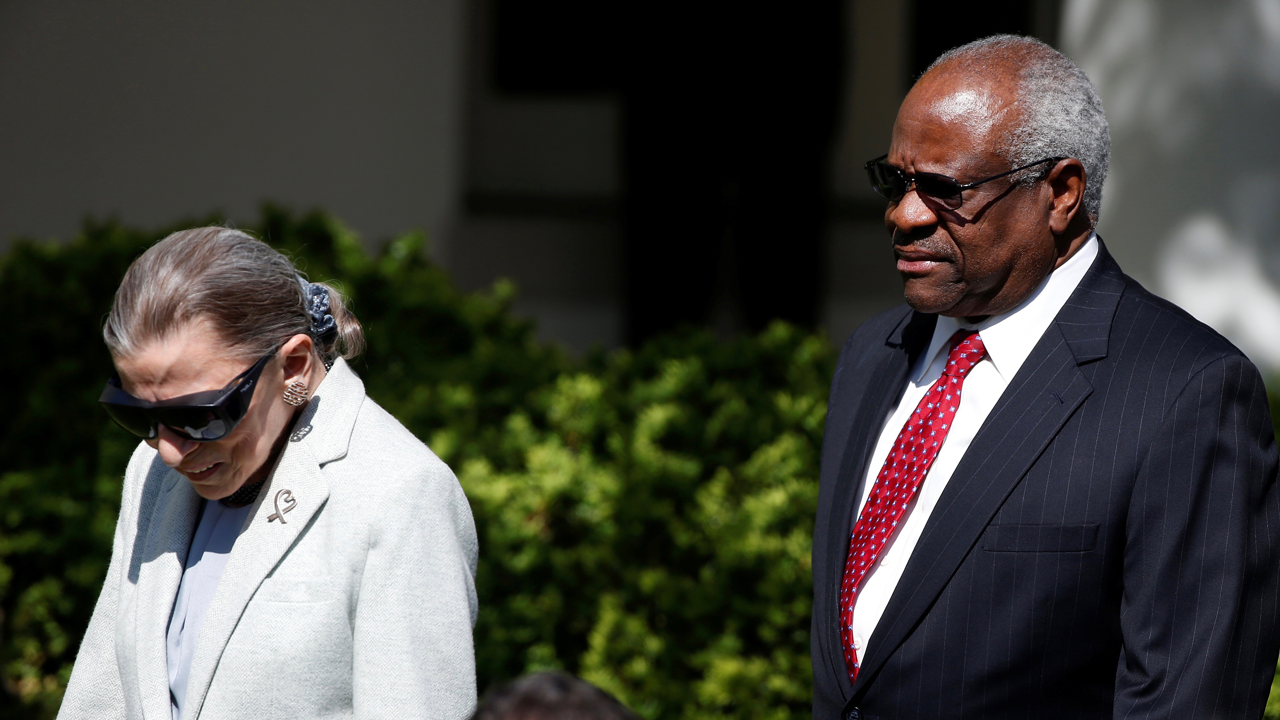 Supreme Court justices Ruth Bader Ginsburg and Clarence Thomas.