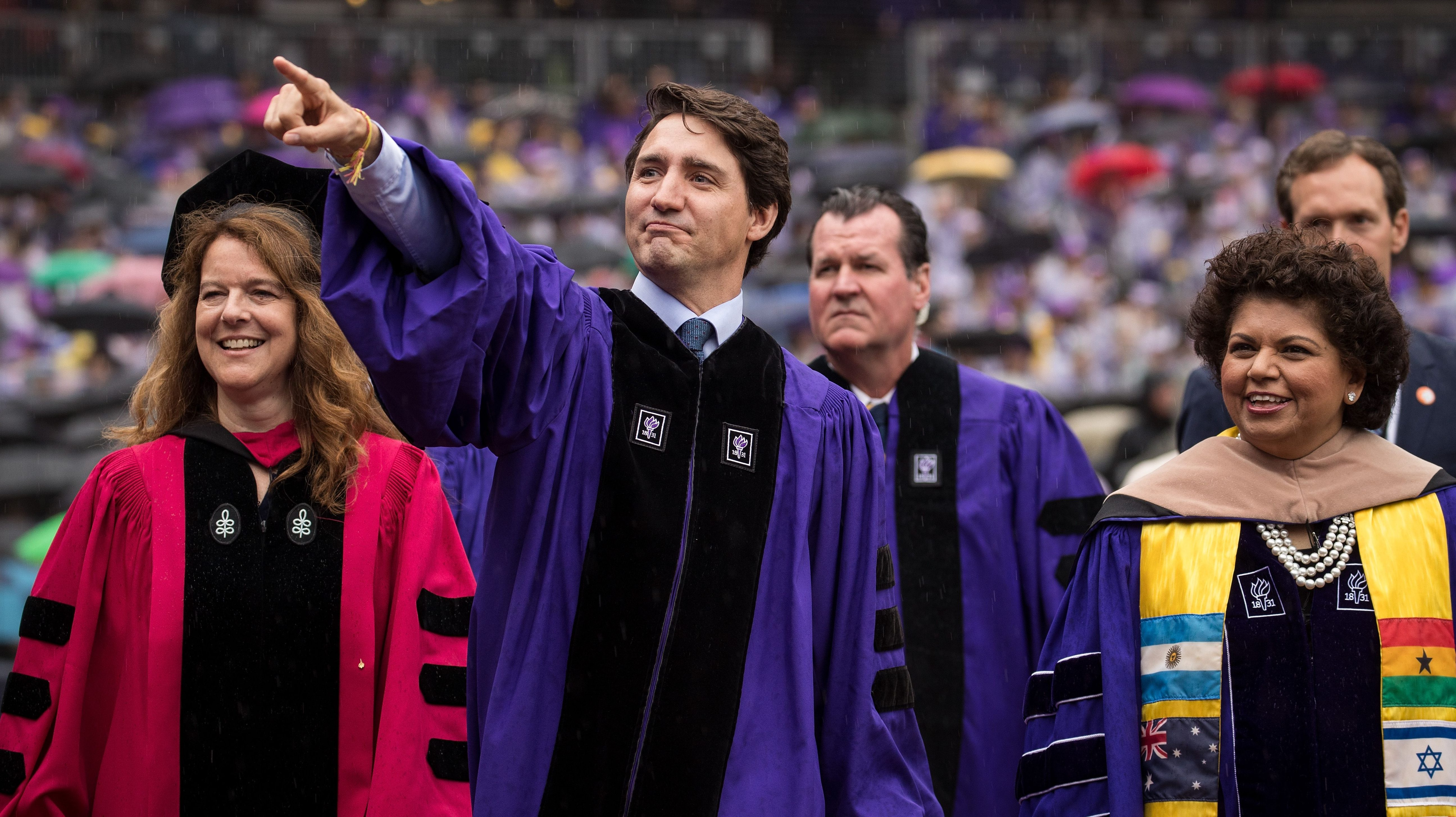 Canadian Prime Minister Justin Trudeau gestures as he arrives for New York University's commencement ceremony at Yankee Stadium, on May 16, 2018 in the Bronx borough of New York City.