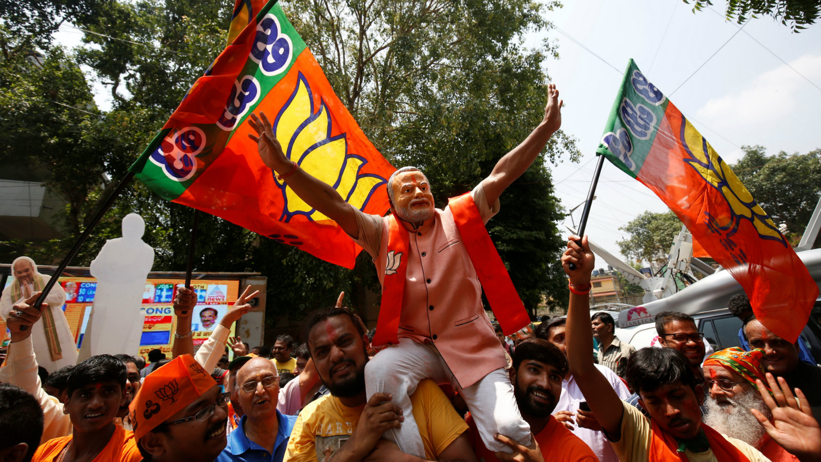 Supporters of India's ruling Bharatiya Janata Party (BJP) celebrate after learning of the initial poll results of Karnataka state assembly elections, in Bengaluru, India May 15, 2018.