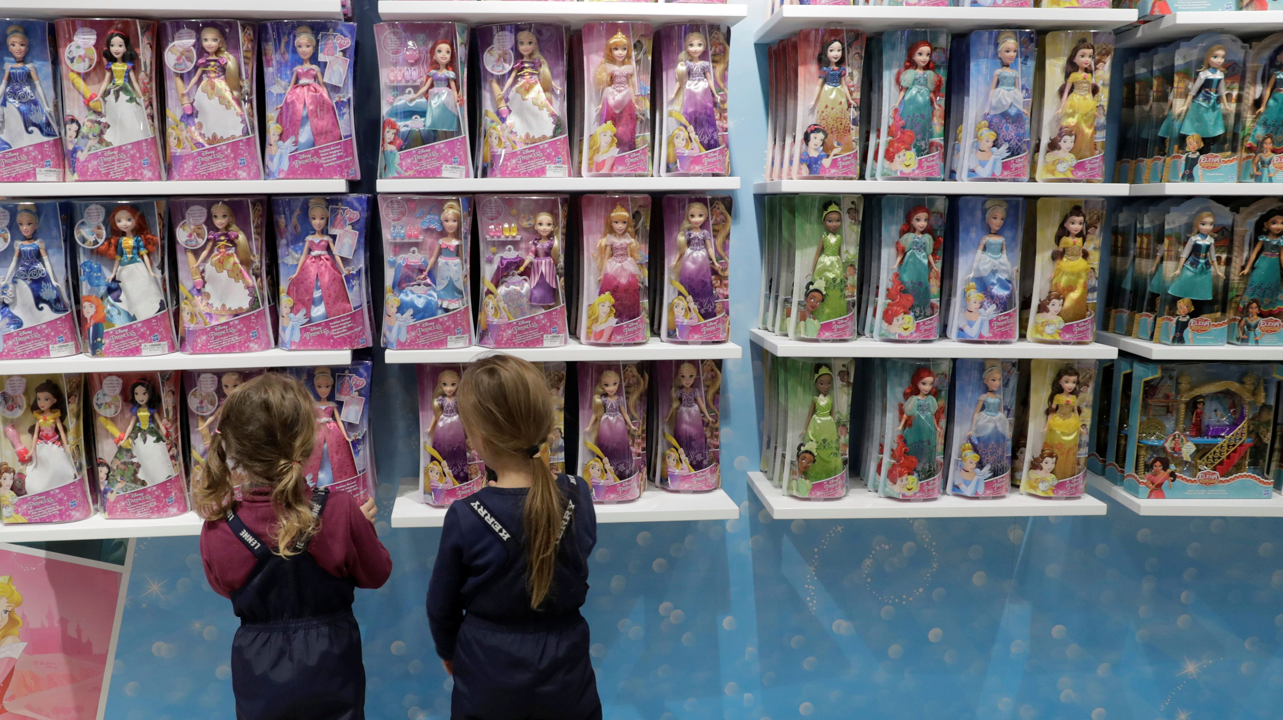 Children look at toys displayed for sale at the first Disney store opened in Moscow, Russia, on December 1, 2017.