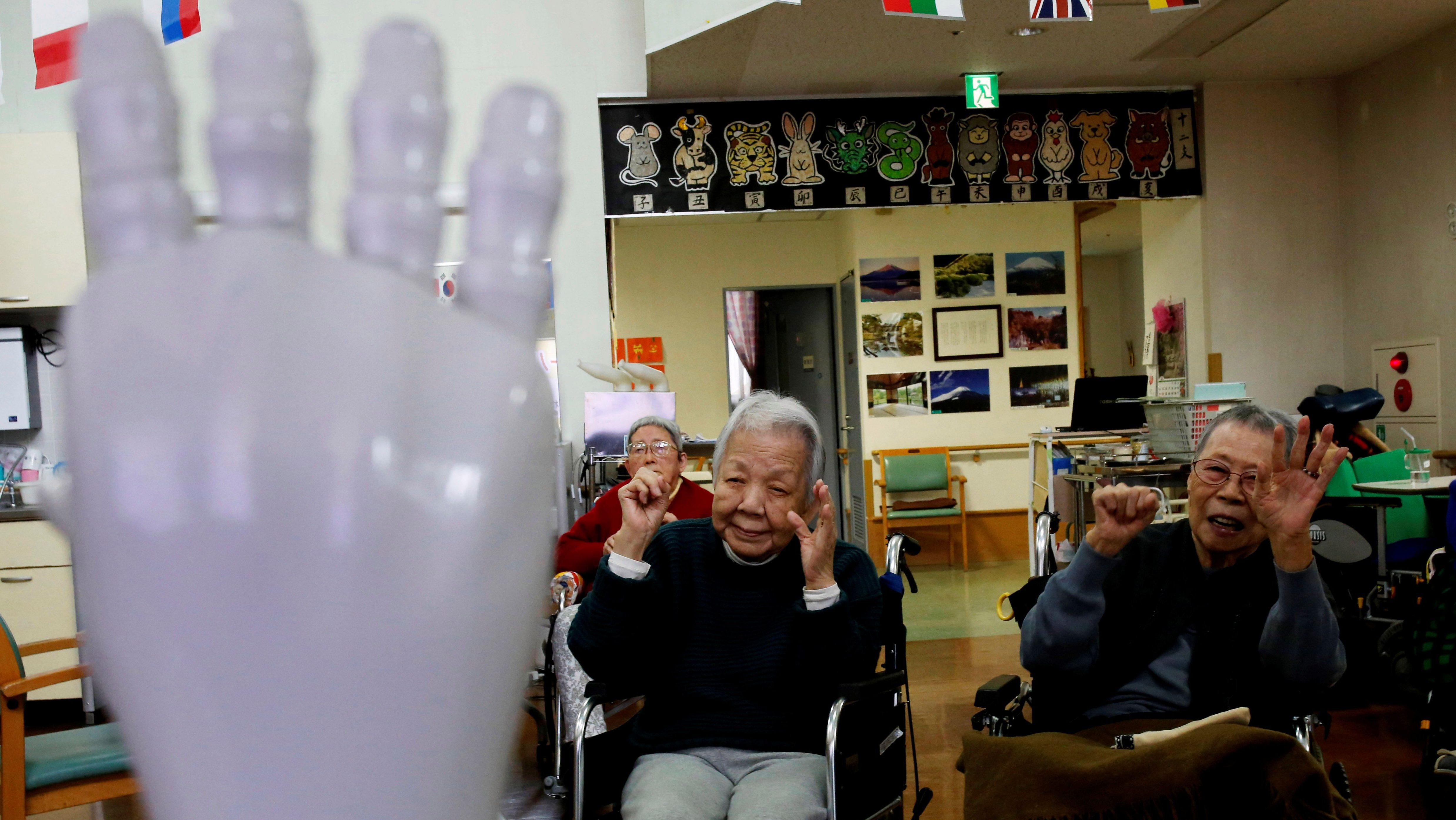 Residents follow moves made by humanoid robot 'Pepper' during an afternoon exercise routine at Shin-tomi nursing home in Tokyo, Japan, February 2, 2018.