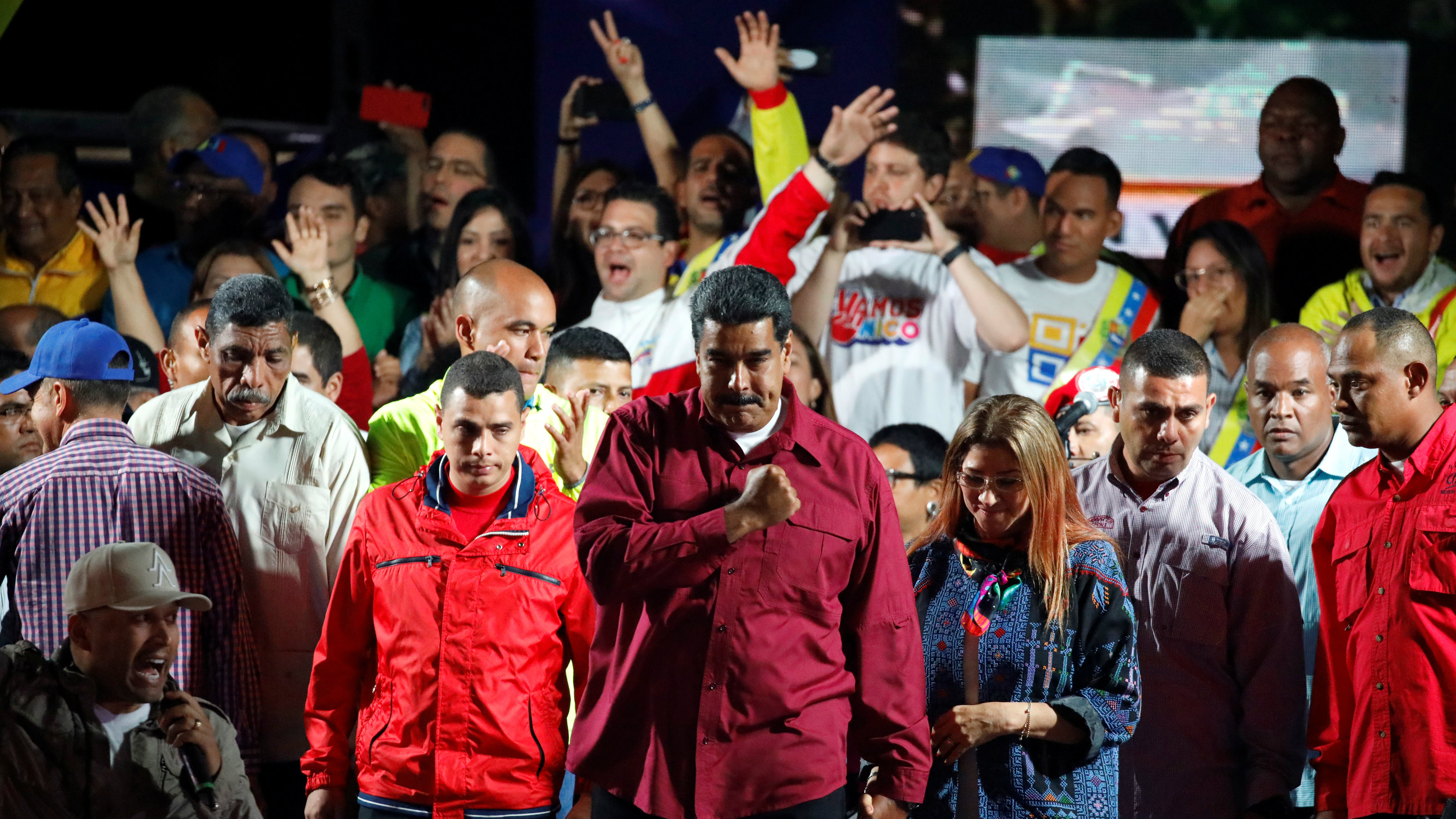 Venezuela's President Nicolas Maduro stands with supporters during a gathering after the results of the election were released