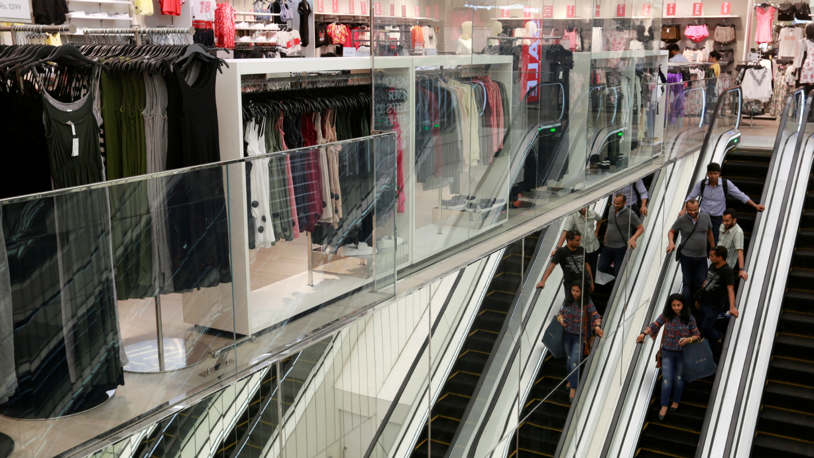 Shoppers ride escalators inside a store at a mall in Mumbai, India, July 10, 2017. Picture taken July 10, 2017.