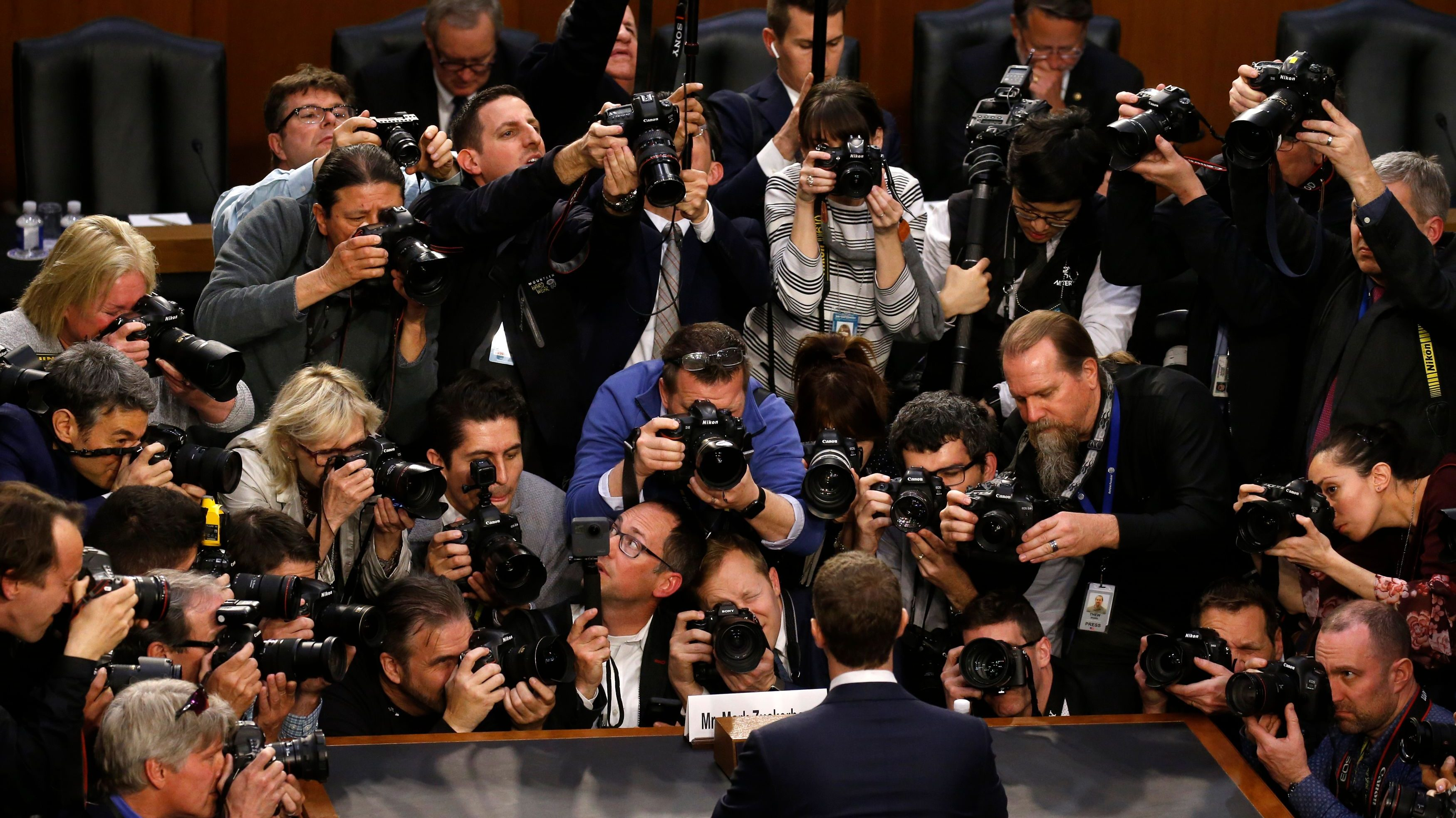 Facebook CEO Mark Zuckerberg is surrounded by members of the media as he arrives to testify before a Senate Judiciary and Commerce Committees joint hearing regarding the company's use and protection of user data, on Capitol Hill in Washington, U.S., April 10, 2018.