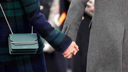 Britain's Prince Harry and his fiancee Meghan Markle hold hands as they arrive at Edinburgh Castle in Edinburgh, Scotland, Tuesday, Feb. 13, 2018.