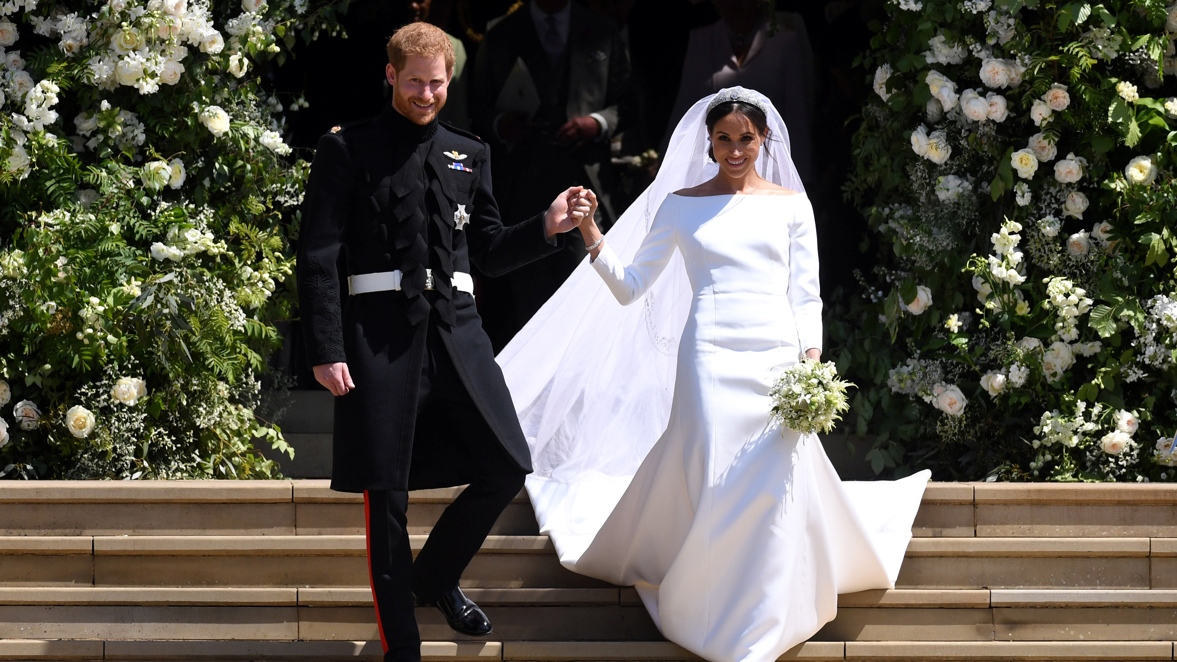 Britain's Prince Harry, Duke of Sussex and Meghan, Duchess of Sussex exit St George's Chapel in Windsor Castle after their royal wedding ceremony, in Windsor, Britain, May 19, 2018.