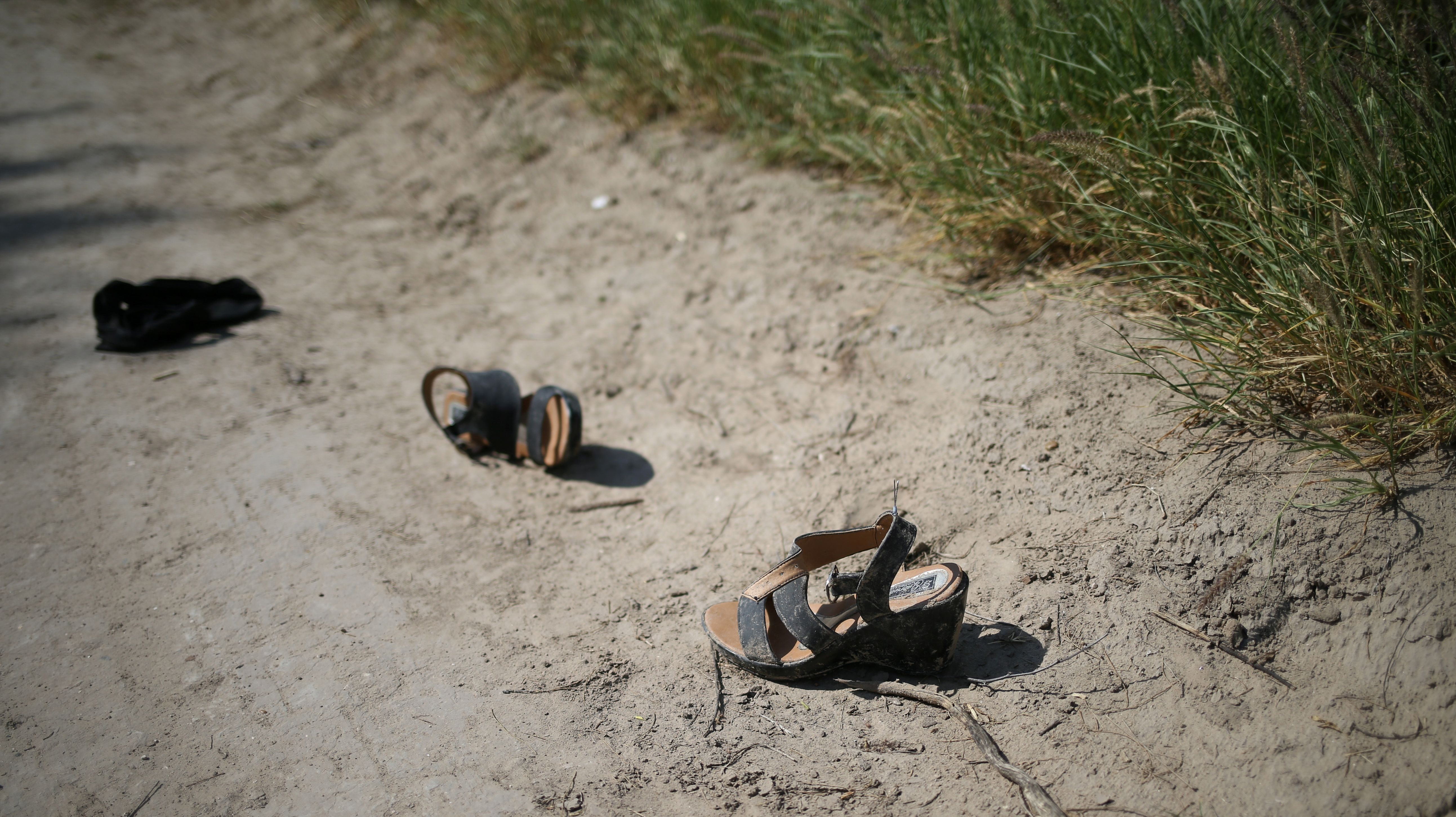 Pictured are shoes left behind on a dirt road used frequently by illegal immigrants at the Mexico-US border near McAllen, Texas, on May 9, 2018.
