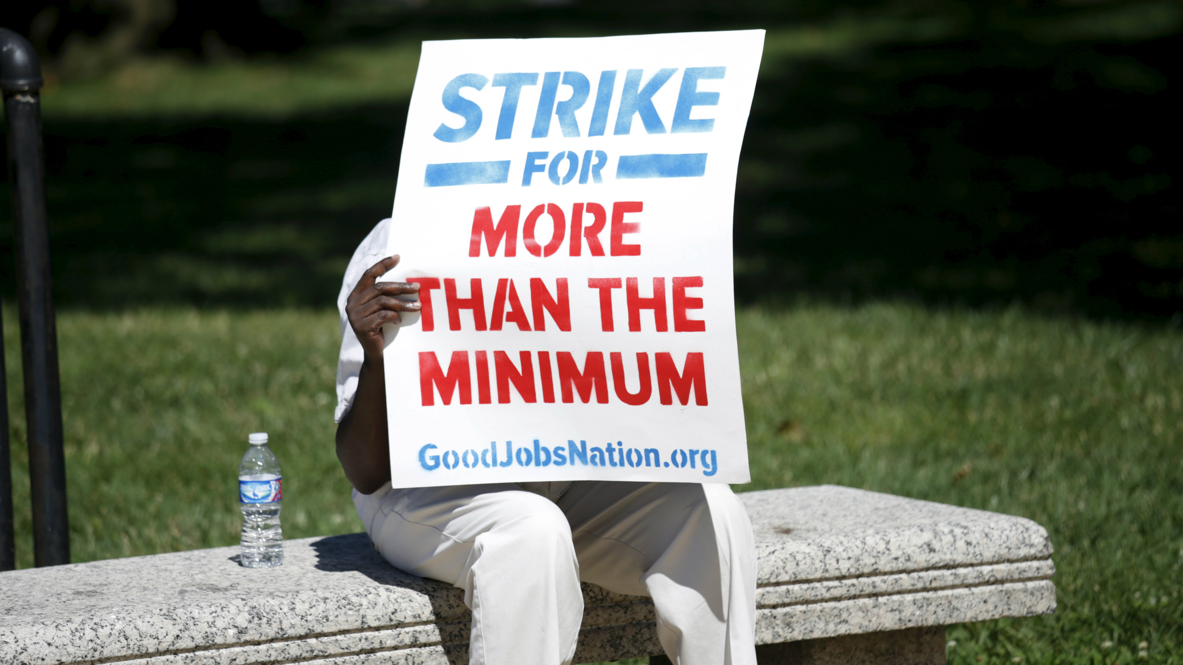A demonstrator with a sign calling for a national $15 minimum wage