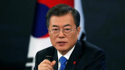 South Korean President Moon Jae-in answers reporters' question during his New Year news conference at the Presidential Blue House in Seoul, South Korea