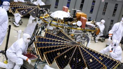 Mars InSight engineers check on the lander's solar panels ahead of launch.