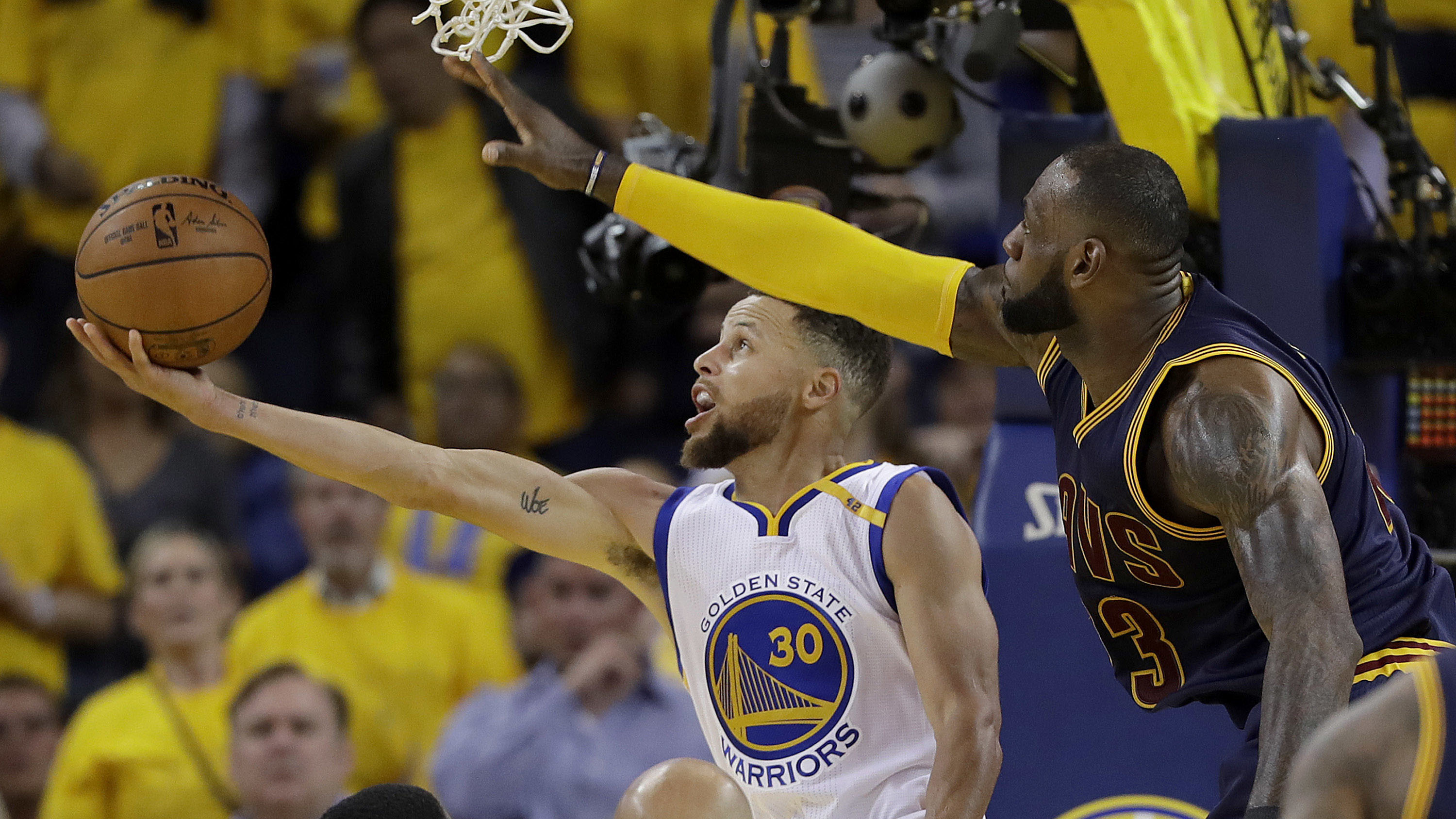 Golden State Warriors guard Stephen Curry (30) shoots against Cleveland Cavaliers forward LeBron James during the second half of Game 1 of basketball's NBA Finals in Oakland, Calif., Thursday, June 1, 2017. (AP Photo/Marcio Jose Sanchez)