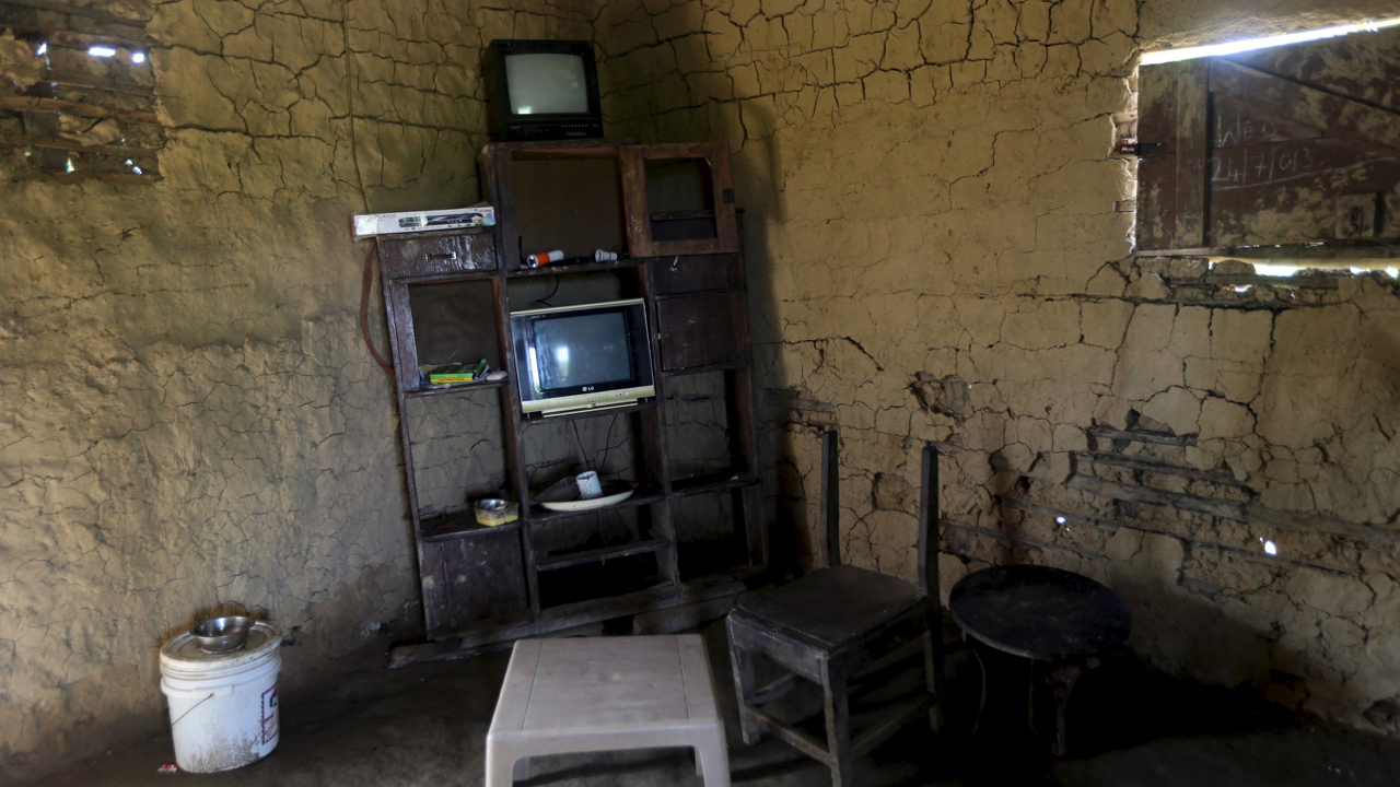 "A shelf containing electronics items, including two televisions, is seen inside a mud house in Ikarama village on the outskirts of the Bayelsa state capital, Yenagoa, in Nigeria's delta region October 8, 2015. Tensions are building in the swampland of the Niger Delta as an amnesty that aimed to bring stability to Nigeria's volatile southern region is due to expire at the end of the year. While the region's towns and cities are mostly calm, local residents say kidnappings and armed robberies are on the increase in the mangrove swamps, where most oil wells are located. Former military ruler and Muslim northerner President Muhammadu Buhari said in his inauguration speech in May that he might ""streamline"" the amnesty, implemented in 2009 by his predecessor, Goodluck Jonathan, a Christian like most of the Delta population. The deal aimed to pacify militants fighting for a greater share of oil revenues in Africa's biggest crude producer. At risk are payouts worth $300 million a year to 30,000 youths, money designed to discourage them from blowing up pipelines or kidnapping oil workers in a region where basic services are almost non-existent.   REUTERS/Akintunde Akinleye   PICTURE 15 OF 24 FOR WIDER IMAGE STORY ""TENSIONS IN THE NIGER DELTA"". SEARCH ""DELTA TENSION"" FOR ALL IMAGES. - GF10000243335"