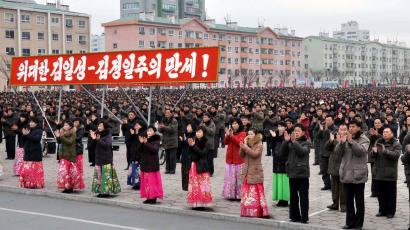 People rally to hail the completion of the state nuclear force, the cause of building a rocket power under the guidance of the Workers' Party of Korea, in this in this undated photo released by North Korea's Korean Central News Agency (KCNA) on December 6, 2017.