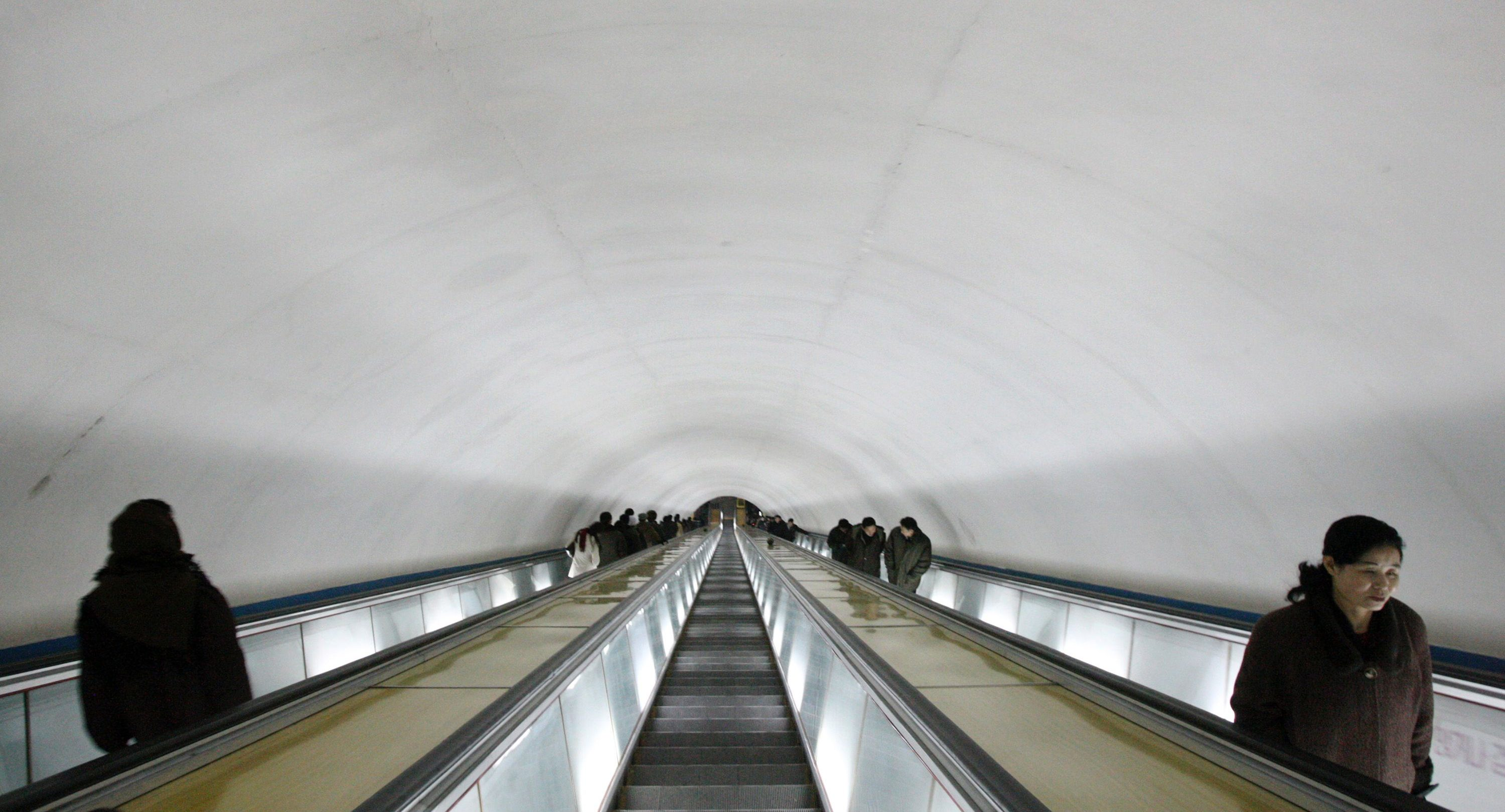 North Korean commuters ride up and down a deep tunnel into a subway station in Pyongyang, North Korea in this Tuesday, Feb. 26, 2008 photo.