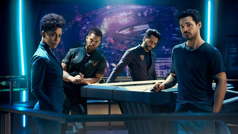 THE EXPANSE -- Season:2 -- Pictured: (l-r) Dominique Tipper as Naomi Nagata, Wes Chatham as Amos Burton, Cas Anvar as Alex Kamal, Steven Strait as Earther James Holden -- (Photo by: Kurt Iswarienko/Syfy)