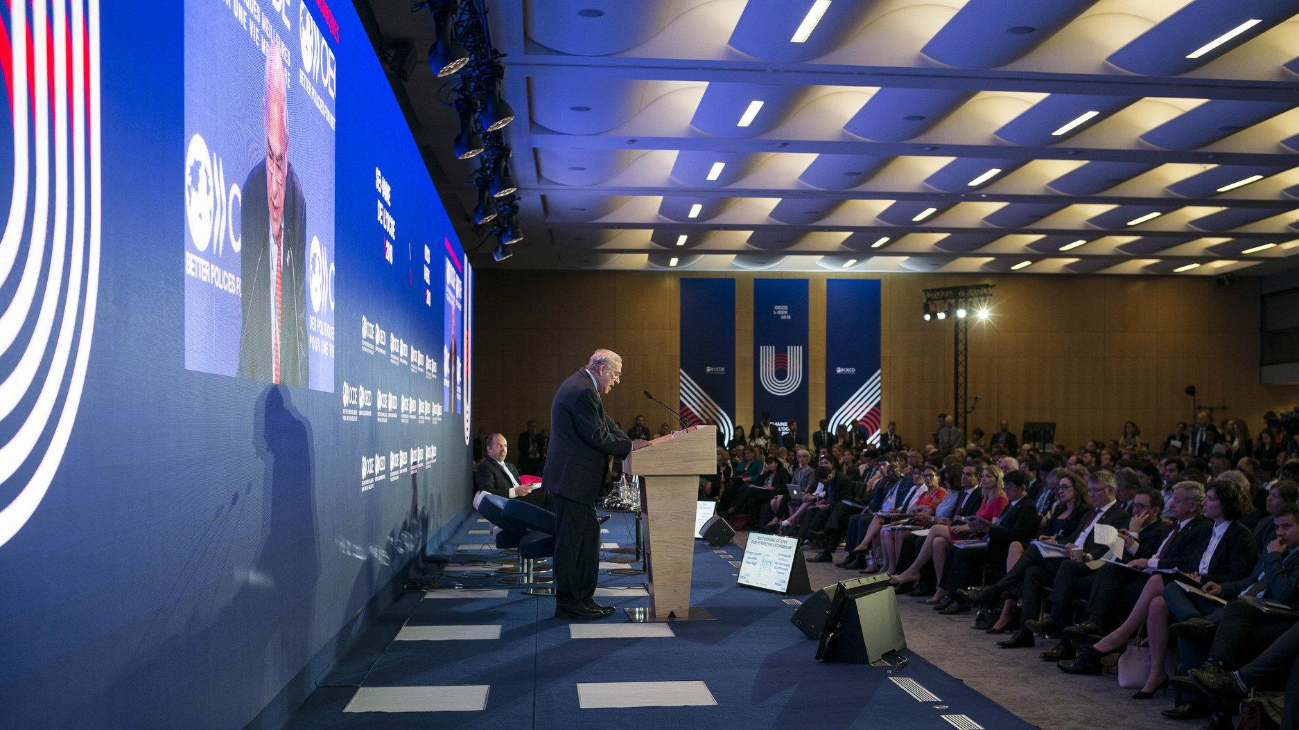 OECD secretary general Angel Gurria addresses conference crowd