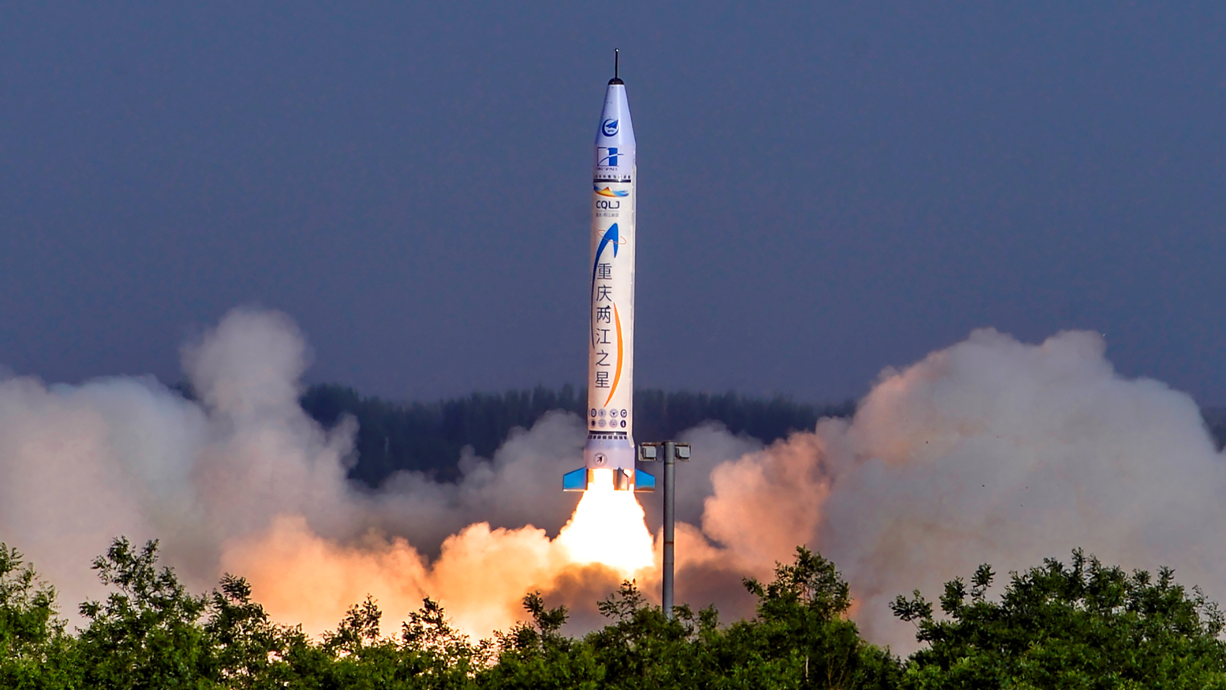 """""""Chongqing Liangjiang Star"""" rocket, developed by Chinese private firm OneSpace Technology, takes off from a launchpad in an undisclosed location in northwestern China May 17, 2018."""