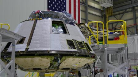 A Boeing CST-100 Starliner spacecraft under construction at Kennedy Space Center.