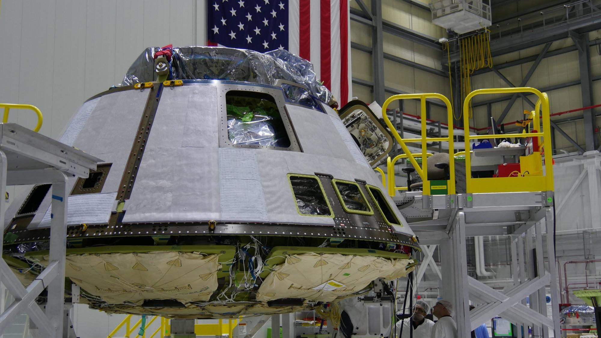 A Boeing CST-100 Starliner spacecraft under construction at Kennedy Space Center.