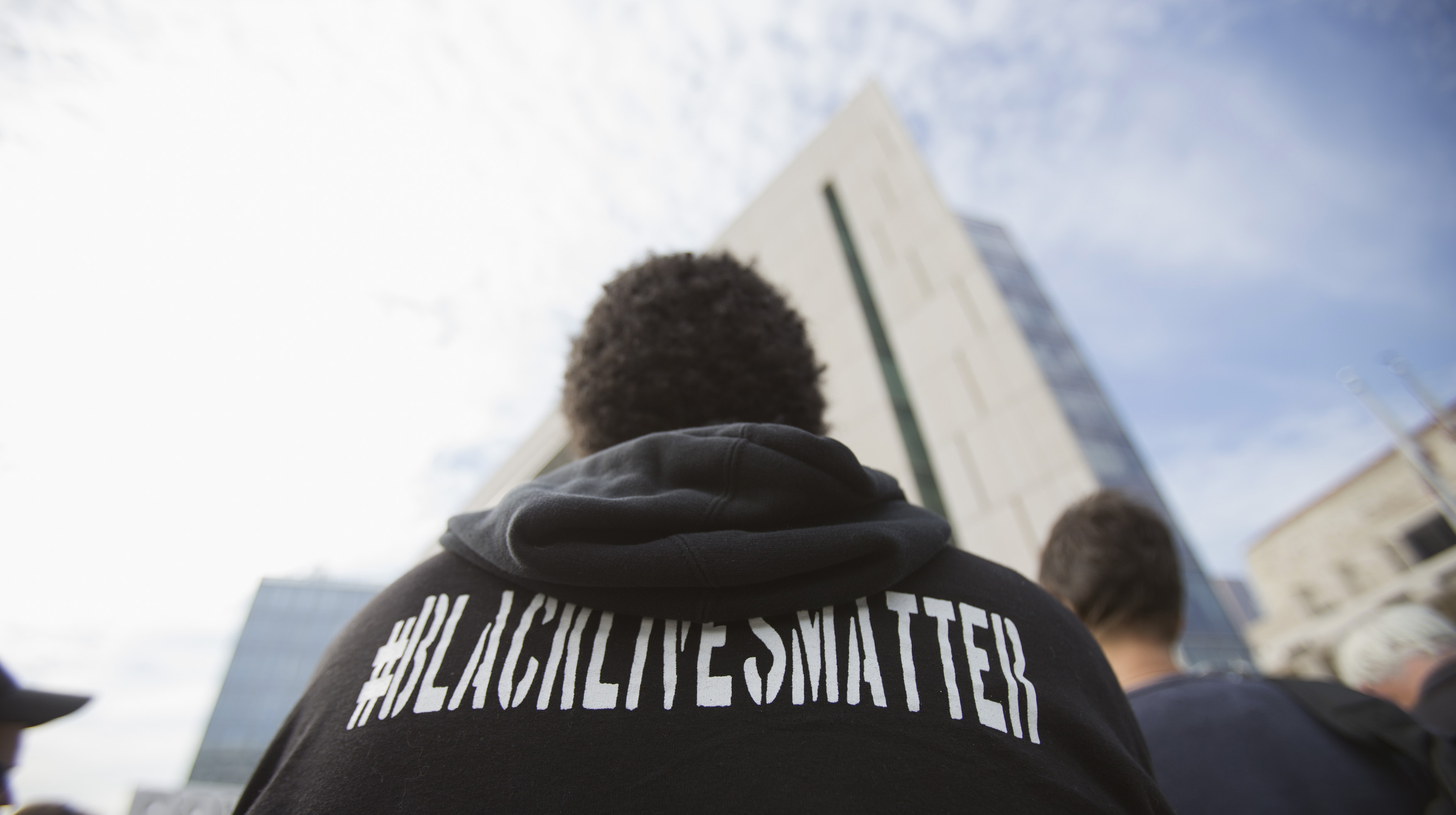 An activist stands during a news conference outside LAPD Headquarters in Los Angeles, California.