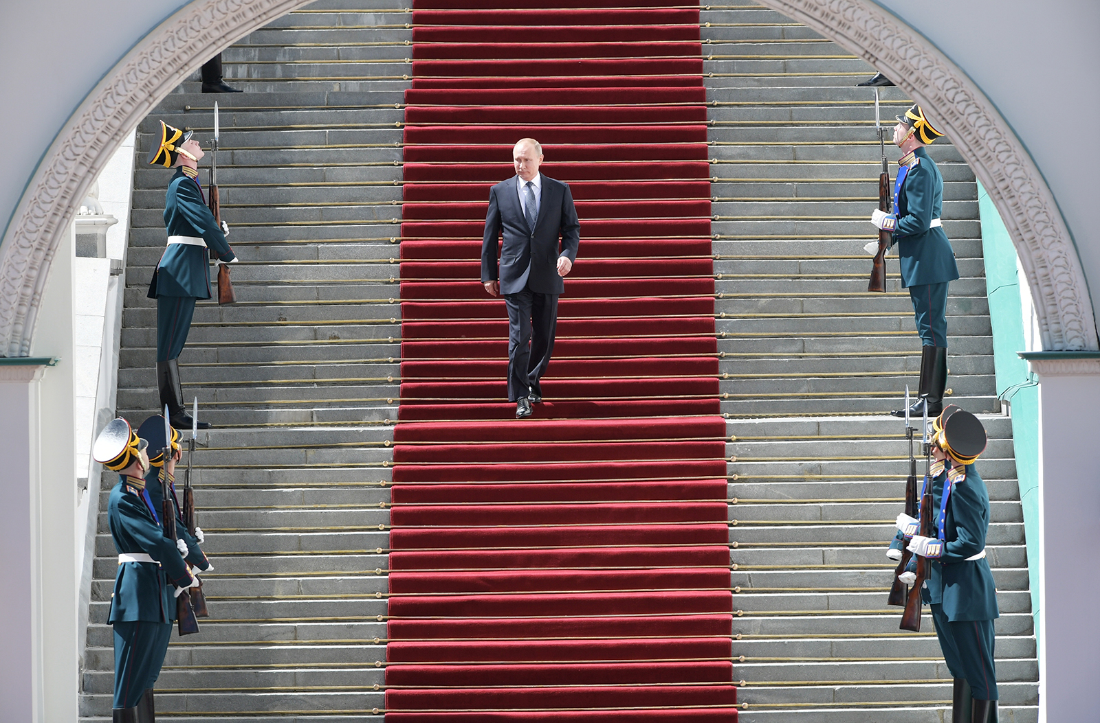 Russian President Putin walks down the stairs after an inauguration ceremony at the Kremlin in Moscow