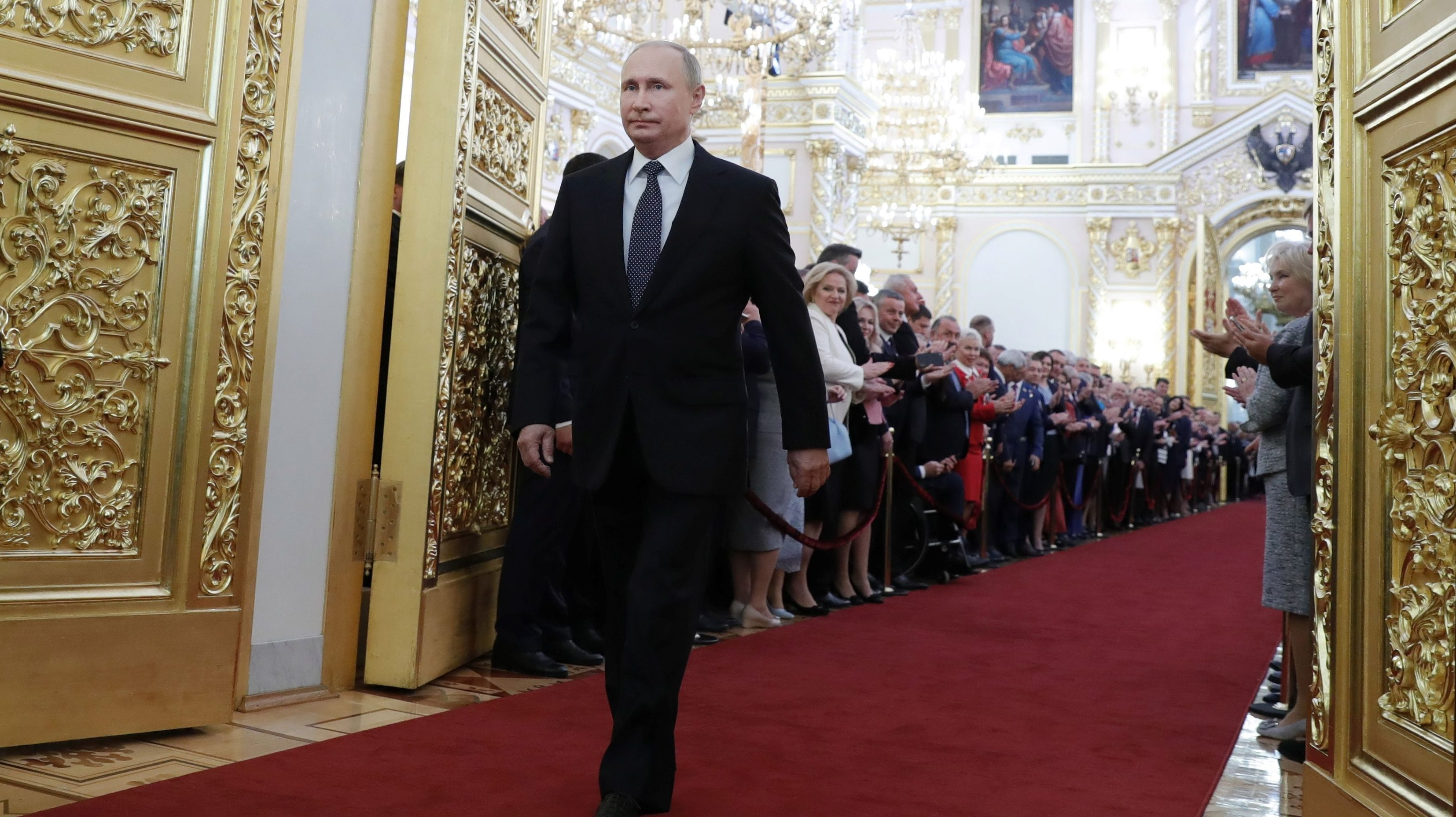 Russian President Vladimir Putin walks before an inauguration ceremony at the Kremlin in Moscow