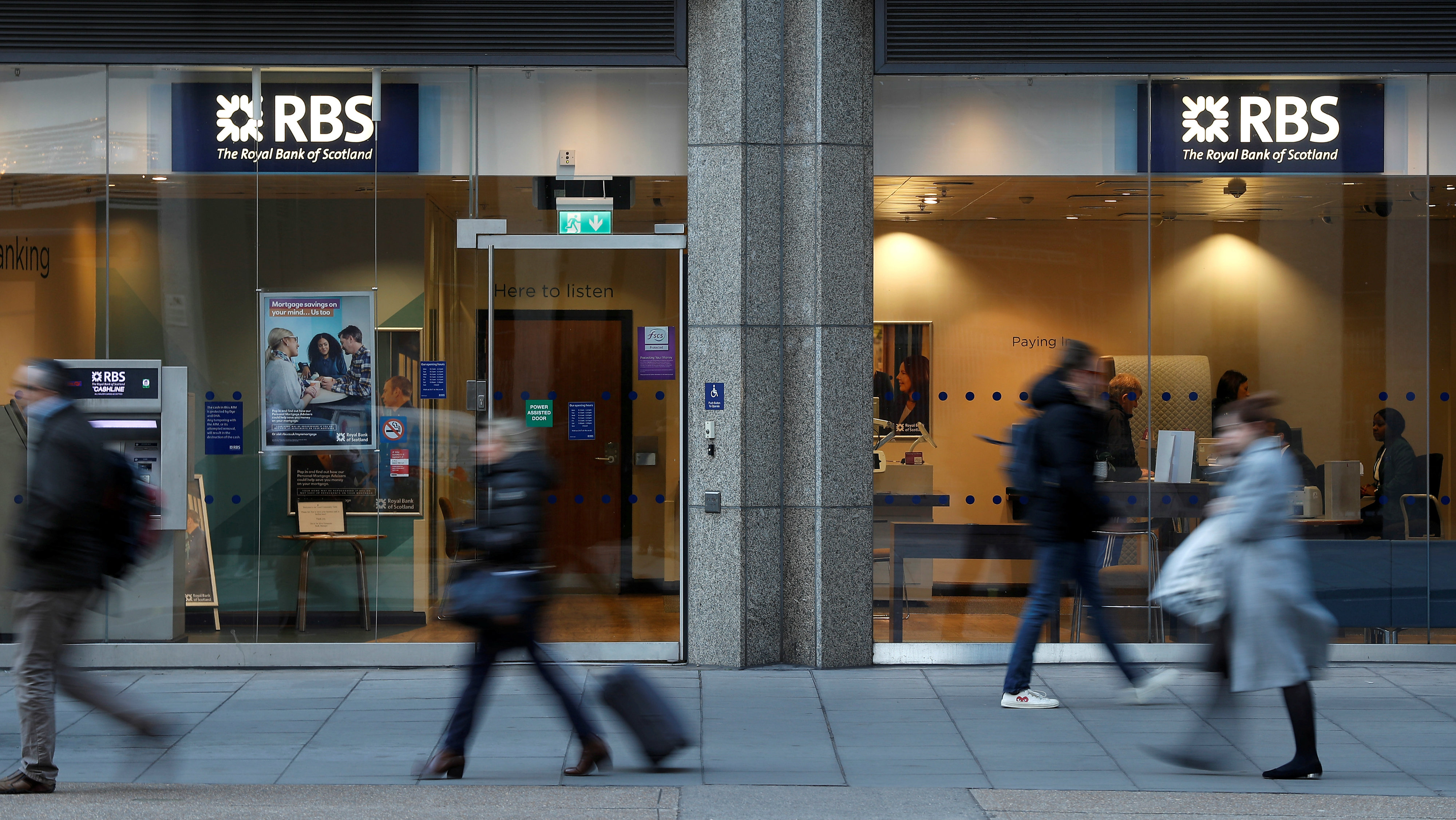 People walk past a branch of the Royal Bank of Scotland in London